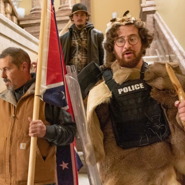 Supporters of President Donald Trump, including Aaron Mostofsky, right, who is identified in his arrest warrant, walk down the stairs outside the Senate Chamber in the U.S. Capitol on Jan. 6, 2021. (Manuel Balce Ceneta / Associated Press)
