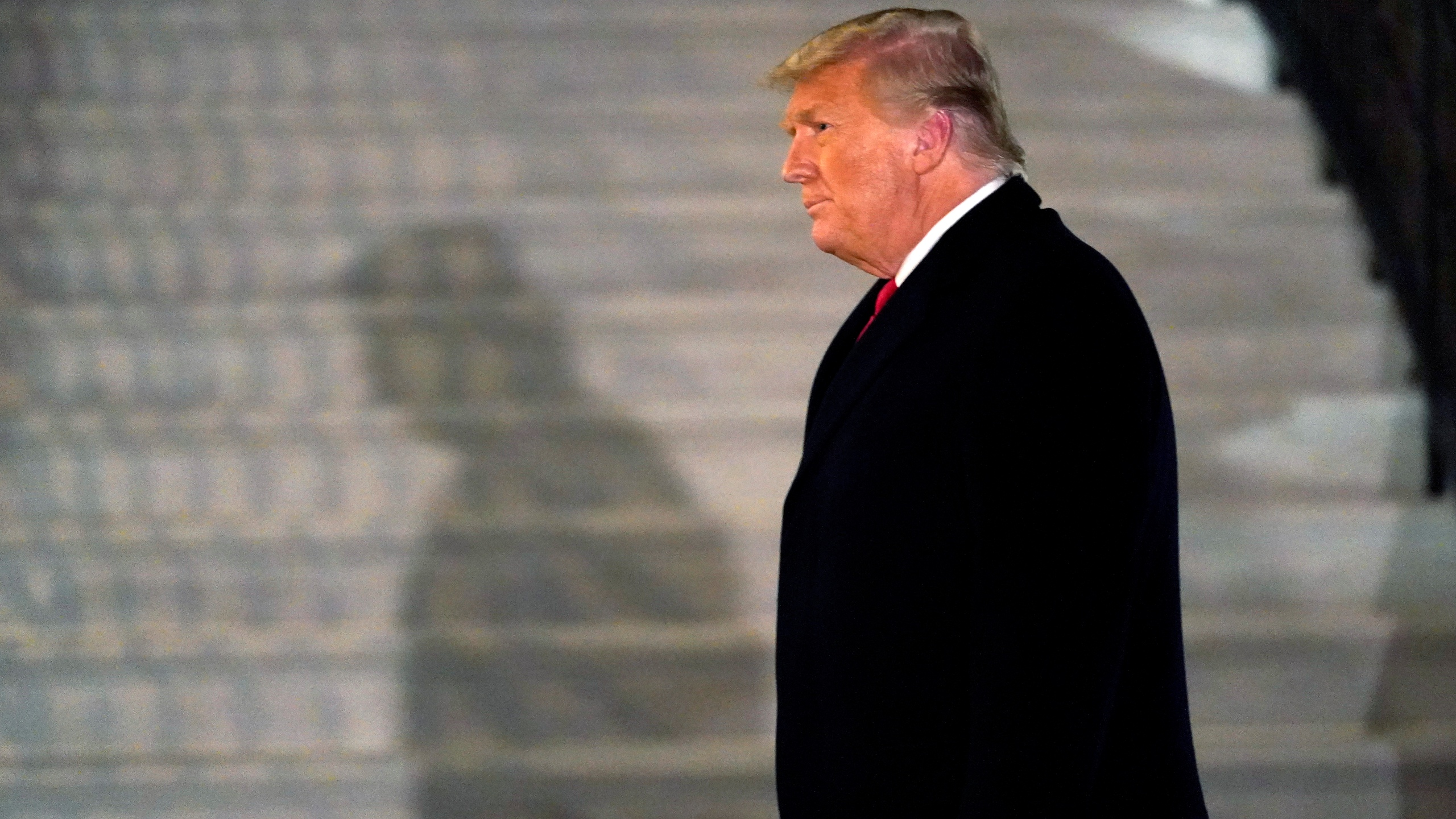 In this Tuesday, Jan. 12, 2021, file photo, President Donald Trump arrives on the South Lawn of the White House, in Washington, after returning from Texas. (AP Photo/Gerald Herbert)
