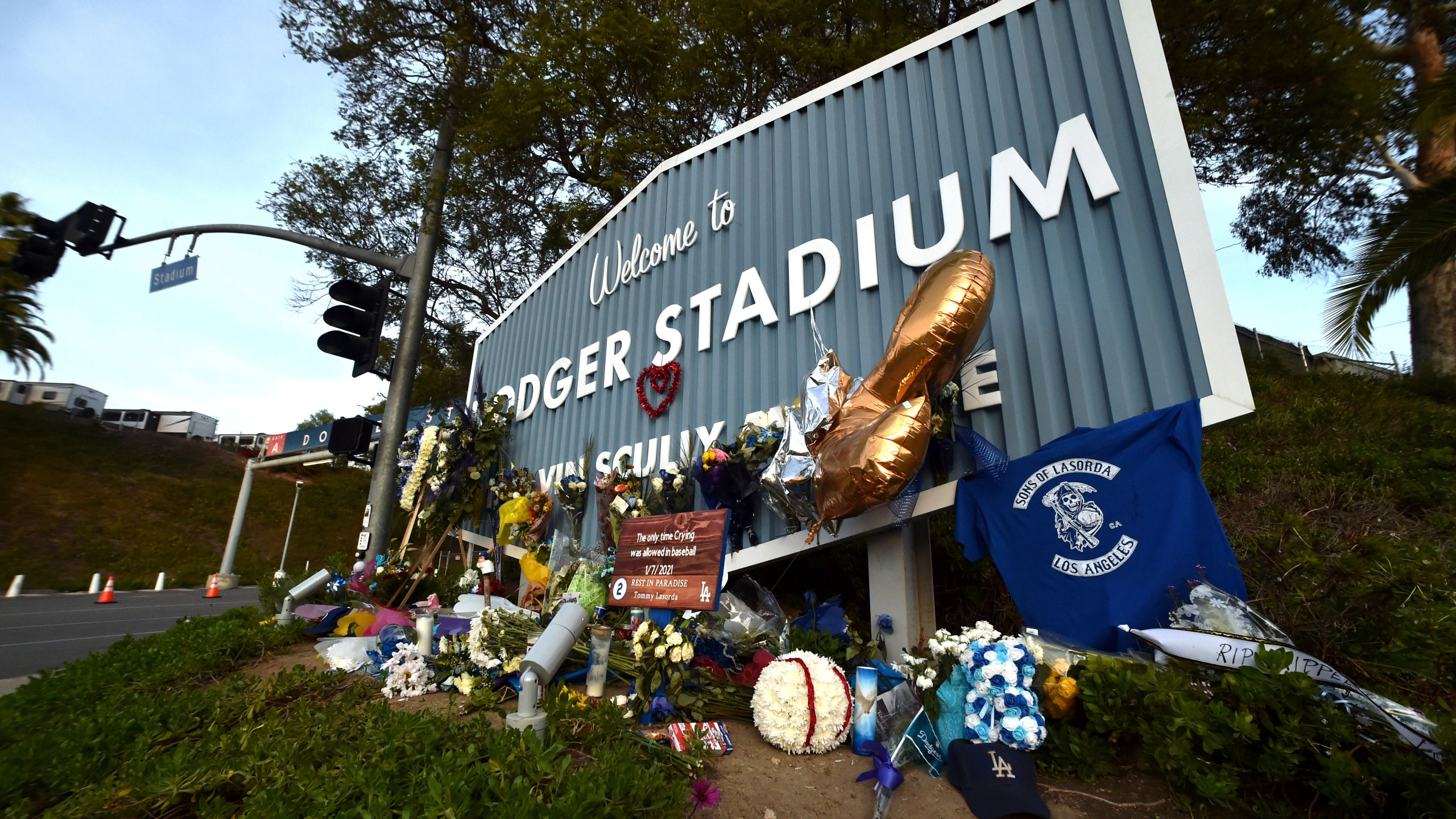 A makeshift memorial along Vin Scully Way in front of Dodger Stadium in Los Angeles on Jan. 13, 2021, honors former Dodgers manager Tommy Lasorda, who died last week. (Keith Birmingham/The Orange County Register via AP)