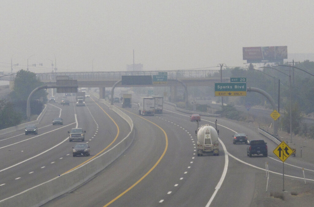 In this Wednesday, Aug. 19, 2020. file photo, smoke from California wildfires up to 200 miles away obscures the view of traffic traveling on Interstate 80, looking west in Sparks, Nev. (AP Photo/Scott Sonner)
