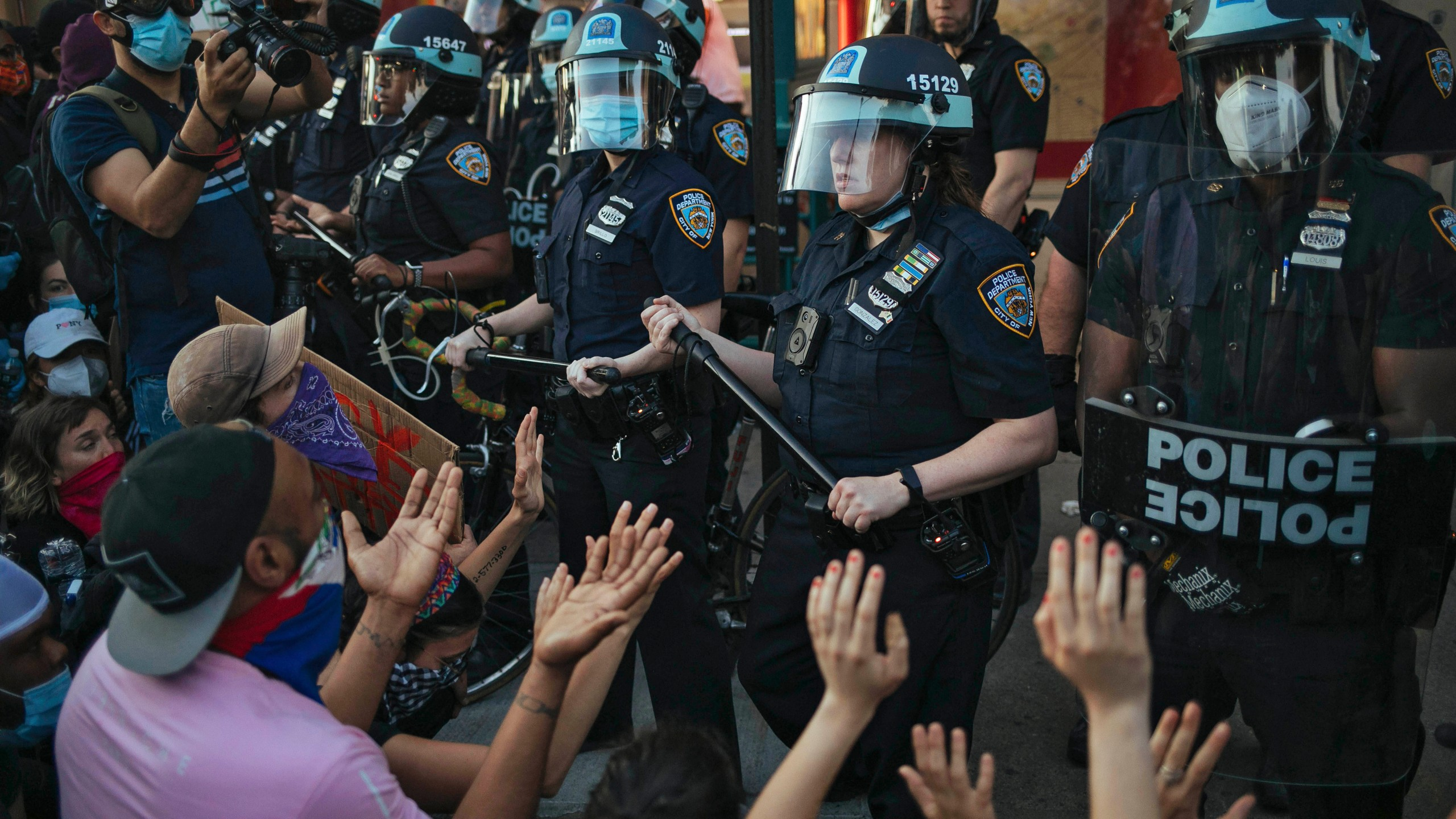 FILE - This May 31, 2020 file photo shows New York City Police facing off with activists during a protest march in the Bedford-Stuyvesant section of the Brooklyn borough of New York. New York's attorney general sued the New York Police Department on Thursday, Jan. 14, 2021 alleging the rough treatment of protesters last spring in the wake of George Floyd's killing was part of a longstanding pattern of abuse that stemmed from inadequate training, supervision and discipline. (AP Photo/Kevin Hagen, FIle)