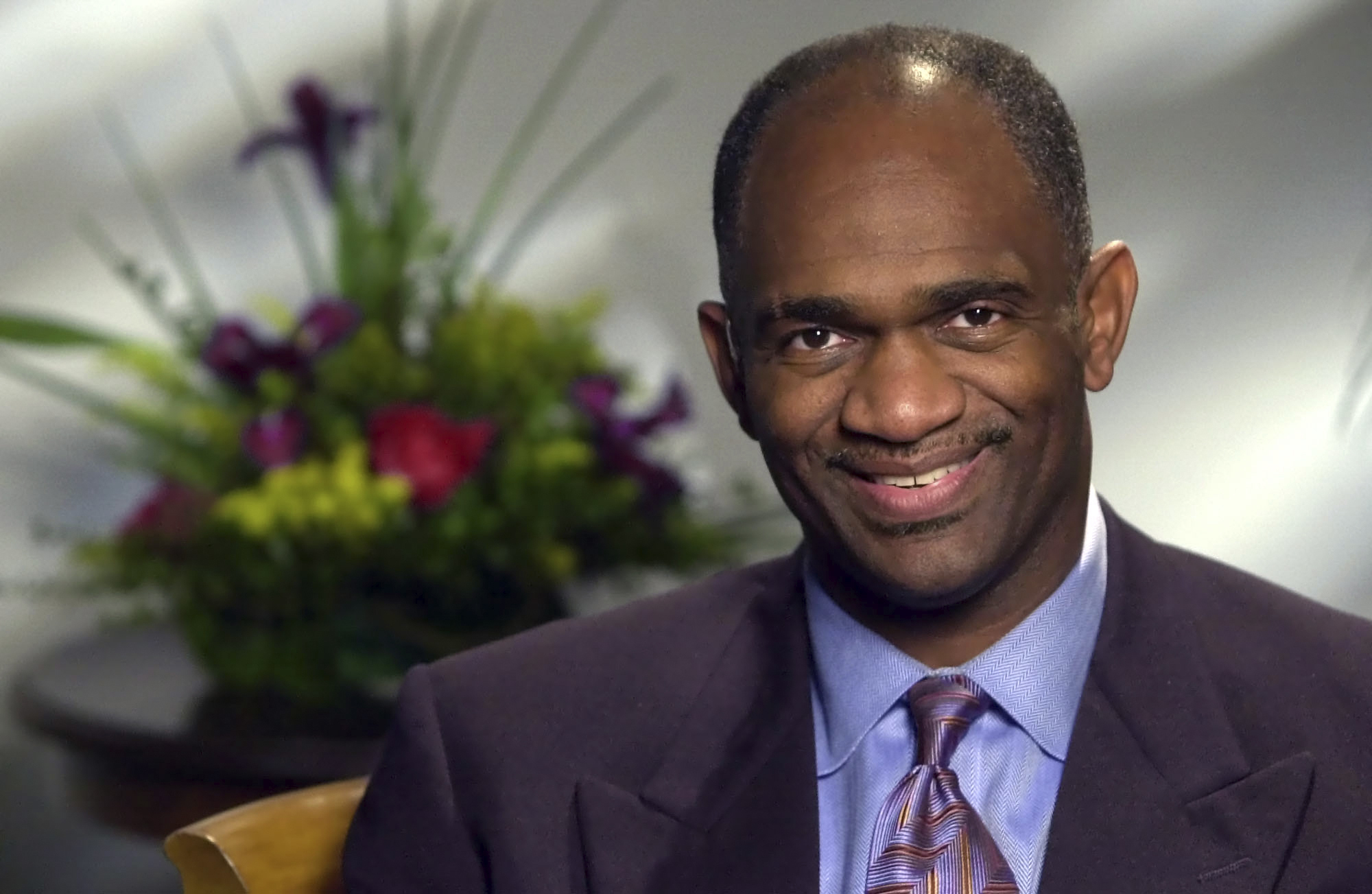 In this July 31, 2000, file photo, Rev. Kirbyjon Caldwell, pastor of Windsor Village United Methodist Church, poses during an interview in Houston. Caldwell a Texas megachurch pastor and former spiritual adviser to two U.S. presidents has been sentenced to six years in prison for bilking investors out of millions of dollars. Caldwell was sentenced Wednesday, Jan. 13, 2021, in Shreveport, La., where he and his co-defendant Gregory A. Smith, were indicted in 2018. (AP Photo/David J. Phillip File)