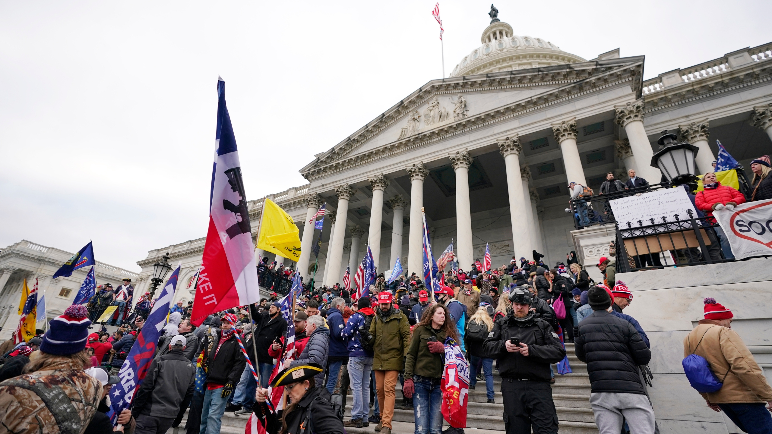 Donald Trump supporters gather outside the Capitol in Washington on Jan. 6, 2021. (Manuel Balce Ceneta / Associated Press)