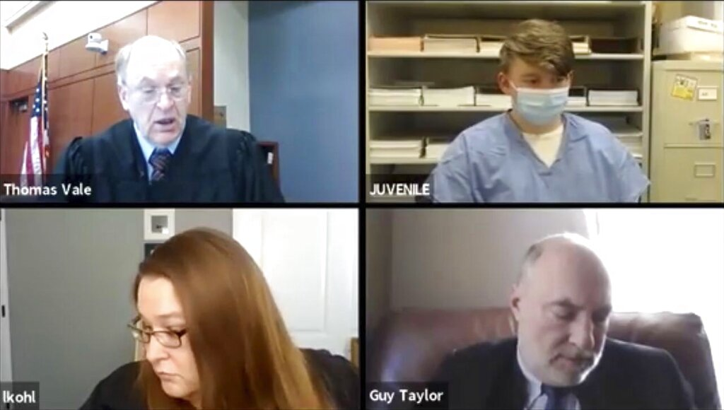 Logan T. Kruckenberg-Anderson, 16, top right, appears by video conference in Green County, Wis. Circuit Court on Tuesday, Jan. 12, 2021 with Circuit Judge Thomas Vale, top left, Assistant District Attorney Laura Kohl and assistant state public defender Guy Taylor. (Wisconsin Circuit Court Access/Wisconsin State Journal via AP)