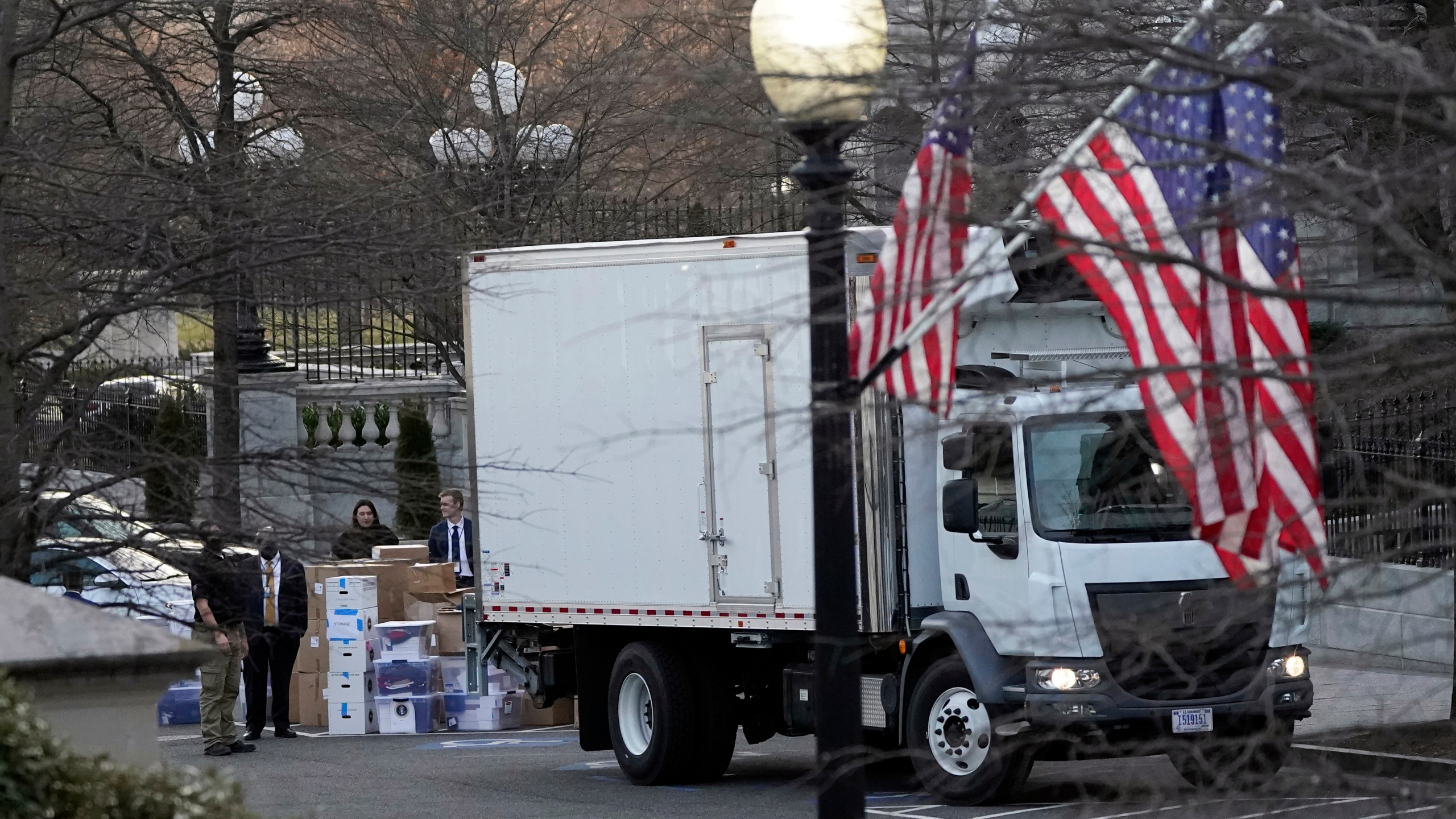 A van arrives to pick up boxes that were moved out of the Eisenhower Executive Office building, inside the White House complex on Jan. 14, 2021, in Washington D.C. (AP Photo/Gerald Herbert)