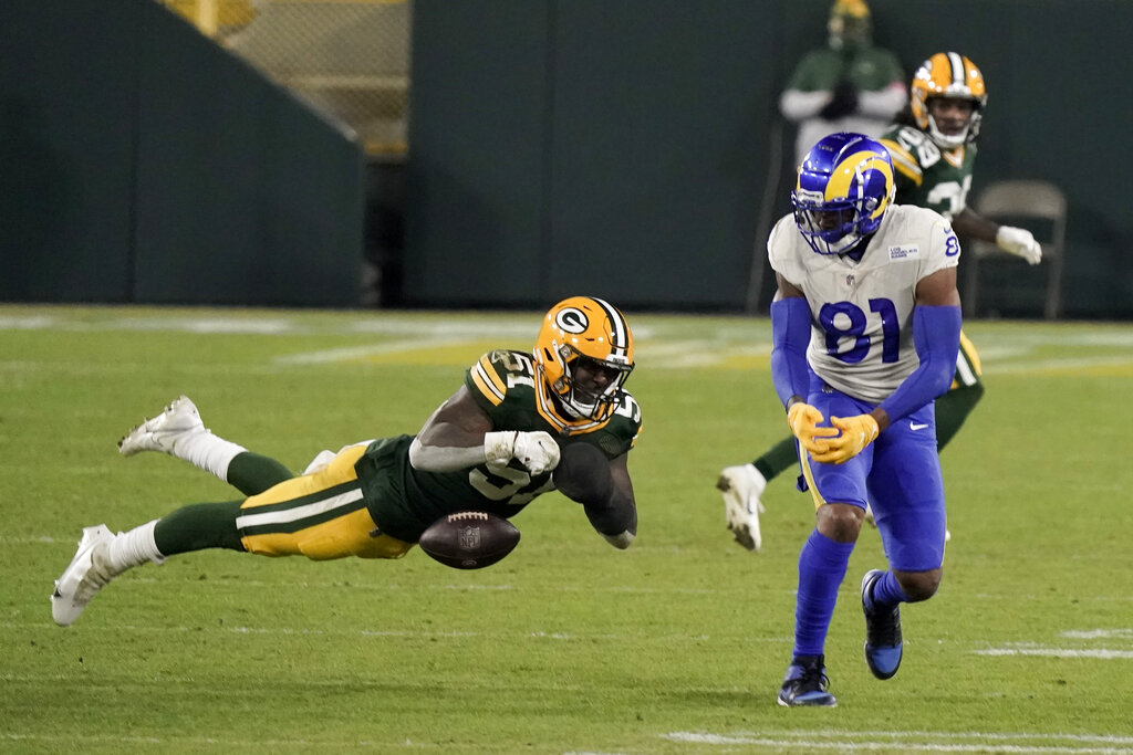 Green Bay Packers' Krys Barnes (51) breaks up a pass intended for Los Angeles Rams' Gerald Everett (81) during the second half of an NFL divisional playoff football game Saturday, Jan. 16, 2021, in Green Bay, Wis. (AP Photo/Morry Gash)