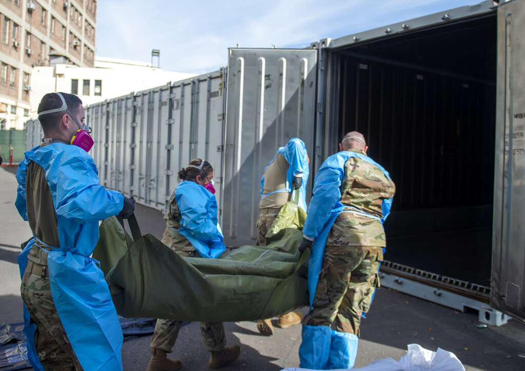 This Jan. 12, 2021, file photo provided by the LA County Dept. of Medical Examiner-Coroner shows National Guard members assisting with processing COVID-19 deaths and placing them into temporary storage at LA County Medical Examiner-Coroner Office in Los Angeles in Los Angeles. (LA County Dept. of Medical Examiner-Coroner via AP, File)