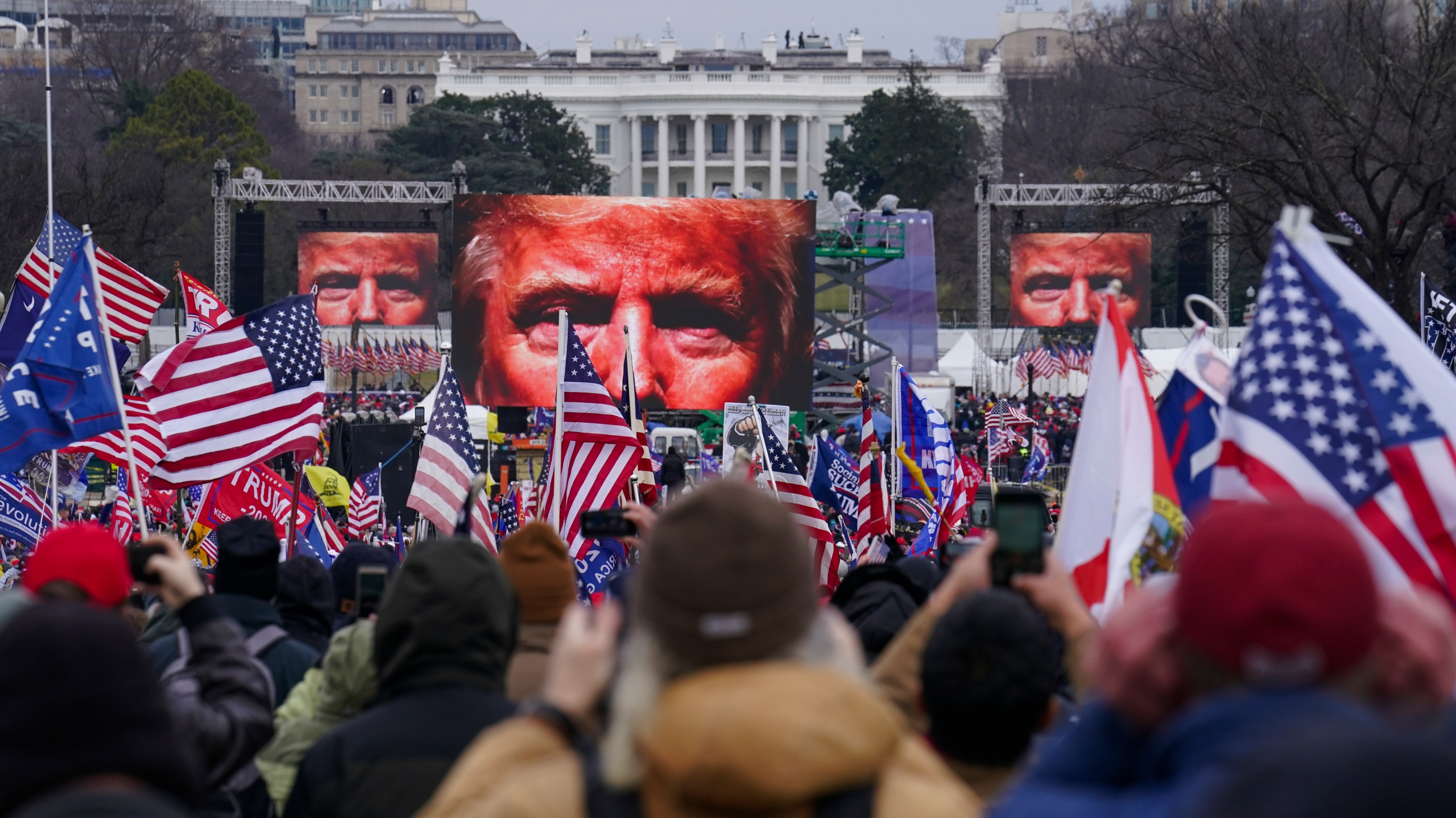 In this Jan. 6, 2021 file photo, Trump supporters participate in a rally in Washington. (AP Photo/John Minchillo)