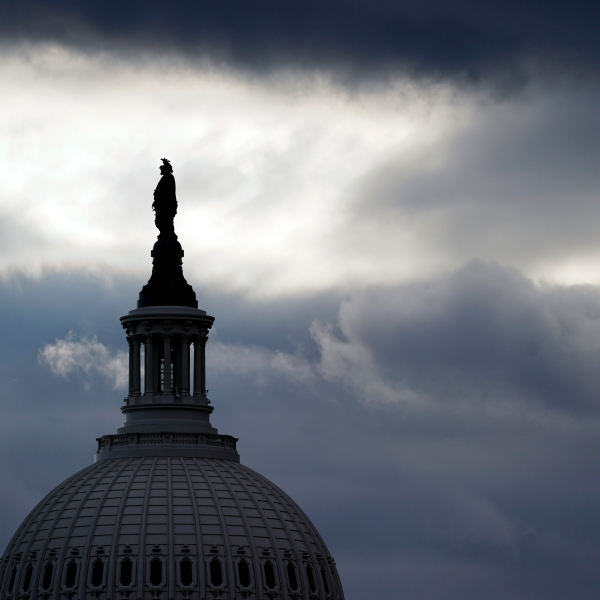 The bronze Statue of Freedom, by Thomas Crawford, is the crowning feature of the dome of the U.S. Capitol, shown ahead of the inauguration of President-elect Joe Biden and Vice President-elect Kamala Harris, Sunday, Jan. 17, 2021, in Washington. (AP Photo/Julio Cortez)