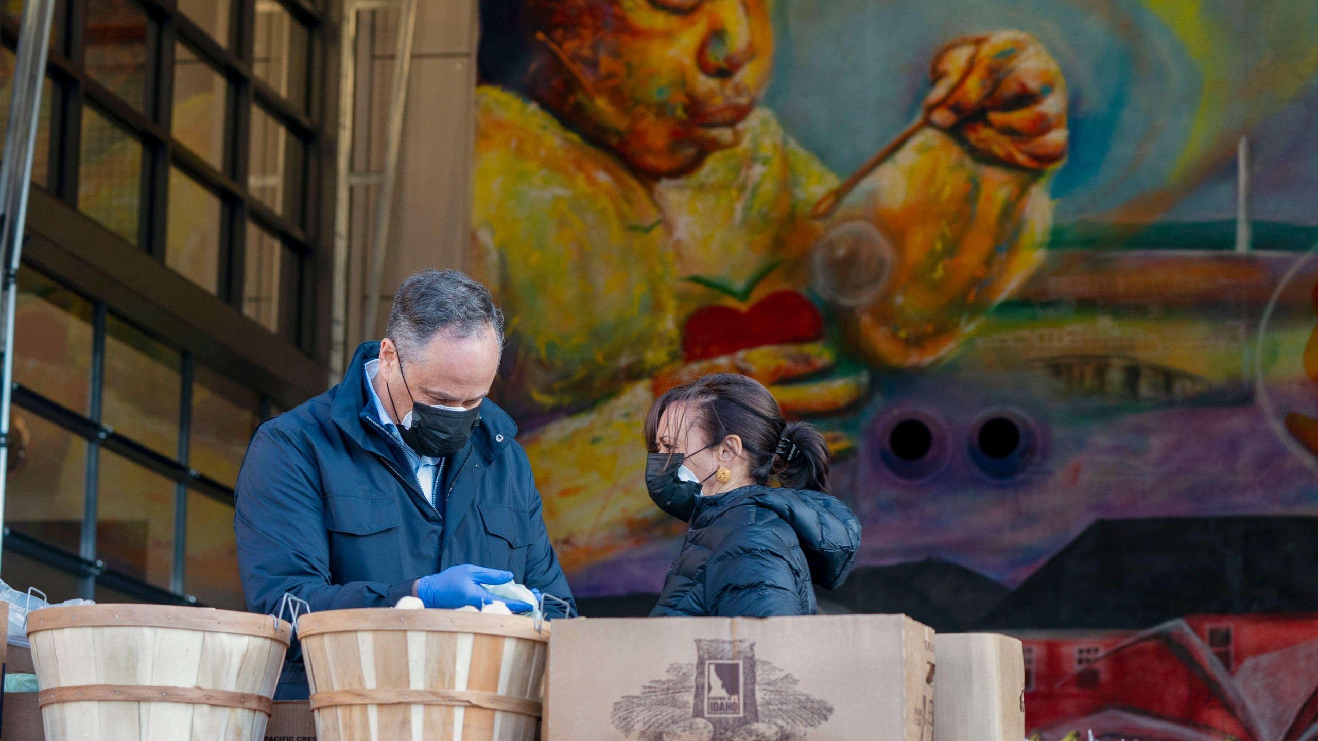 Vice President-elect Kamala Harris, right, and her husband Douglas Emhoff, pack grocery bags for those in need of food while volunteering during the National Day of Service, Monday, Jan. 18, 2021, at Martha's Table in the southeast neighborhood of Washington. (AP Photo/Jacquelyn Martin)