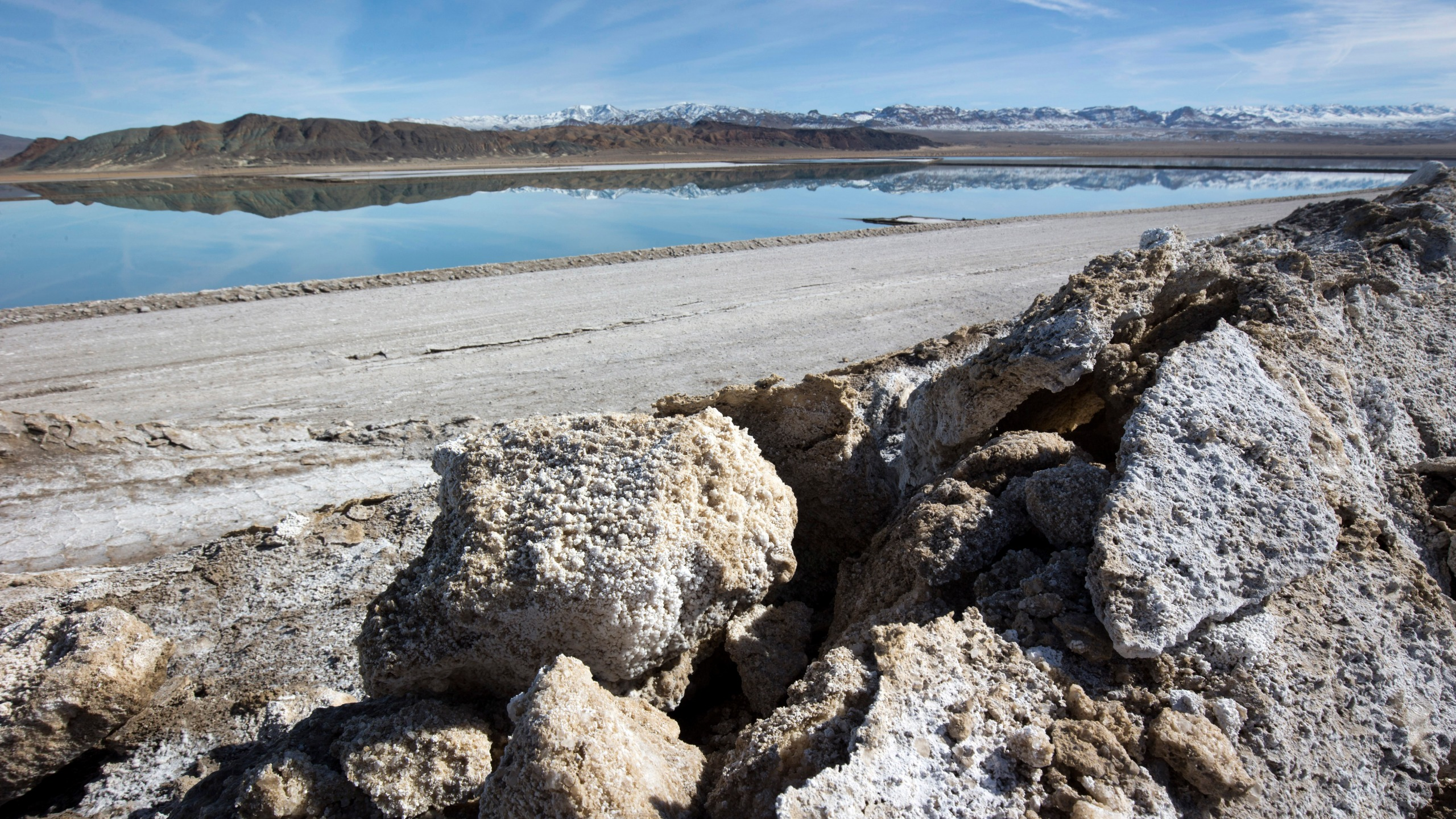 In this Jan. 30, 2017, file photo, waste salt, foreground, is shown near an evaporation pond at the Silver Peak lithium mine near Tonopah, Nev. (Steve Marcus/Las Vegas Sun via AP)