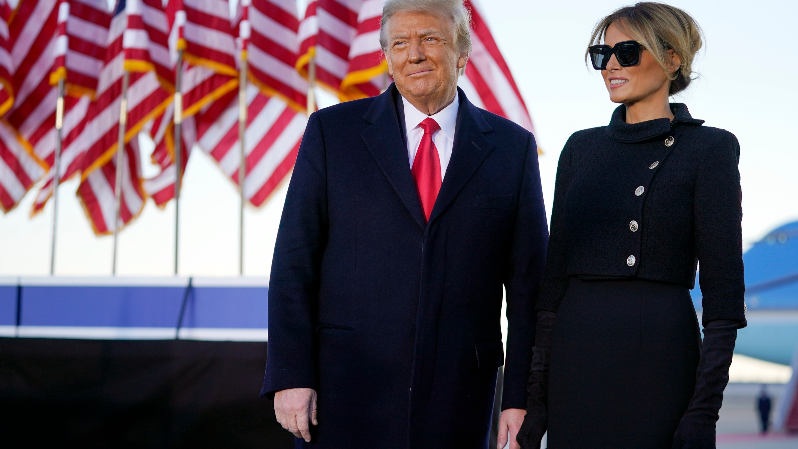 President Donald Trump and first lady Melania Trump look at supporters before boarding Air Force One at Andrews Air Force Base on Jan. 20, 2021.(Manuel Balce Ceneta/Associated Press)