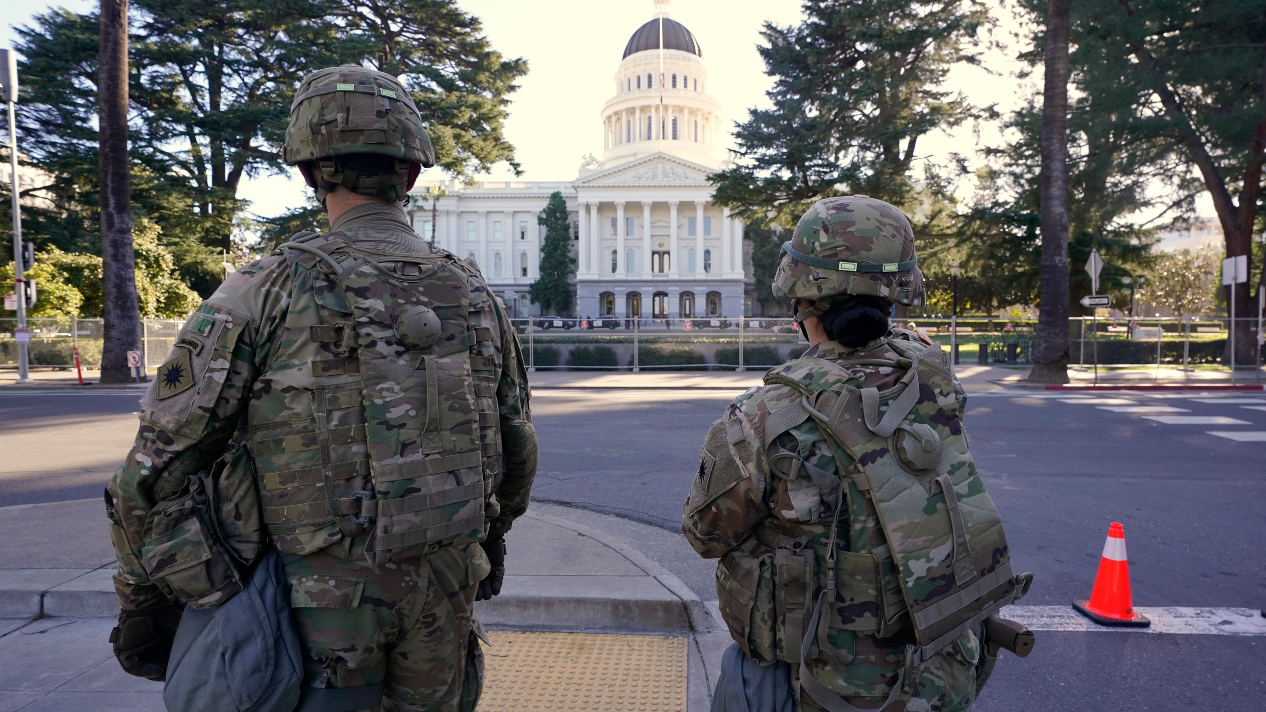 Members of the California National Guard walk past the state Capitol in Sacramento, on Jan. 20, 2021. (AP Photo/Rich Pedroncelli)