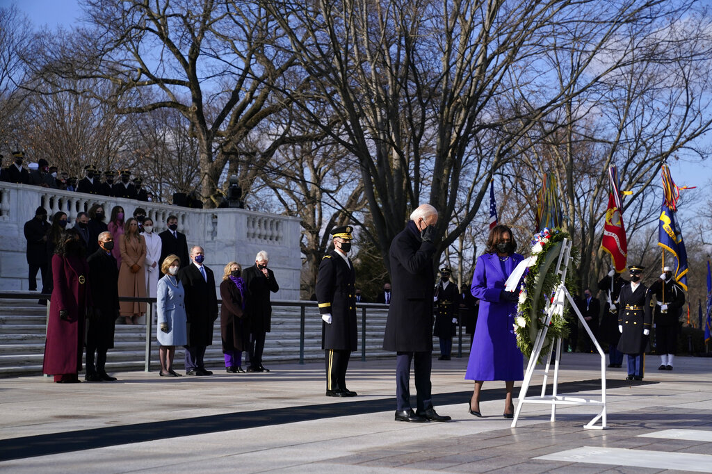 President Joe Biden and Vice President Kamala Harris participate in a wreath laying ceremony at the Tomb of the Unknown Soldier at Arlington National Cemetery in Arlington, Va.(AP Photo/Evan Vucci)