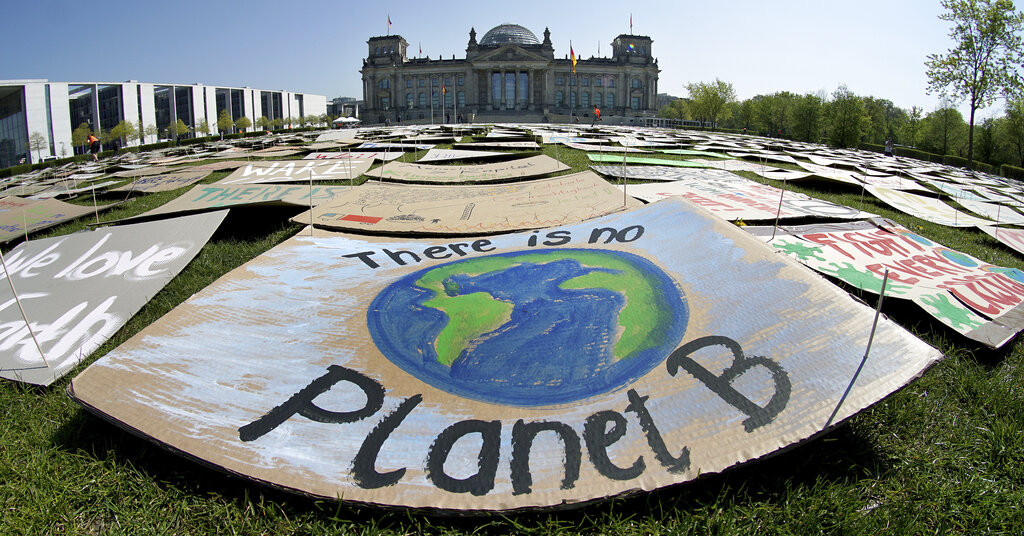 In this Friday, April 24, 2020 file photo, activists place thousands of protest placards in front of the Reichstag building, home of the german federal parliament, Bundestag, during a protest rally of the 'Fridays for Future' movement in Berlin, Germany. (AP Photo/Michael Sohn, File)