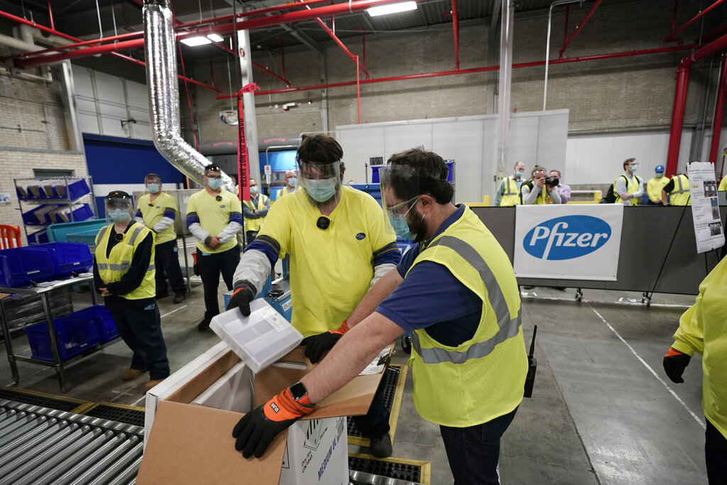 In this Dec. 13, 2020 file photo, Boxes containing the Pfizer-BioNTech COVID-19 vaccine are prepared to be shipped at the Pfizer Global Supply Kalamazoo manufacturing plant in Portage, Mich. (AP Photo/Morry Gash, Pool, File)
