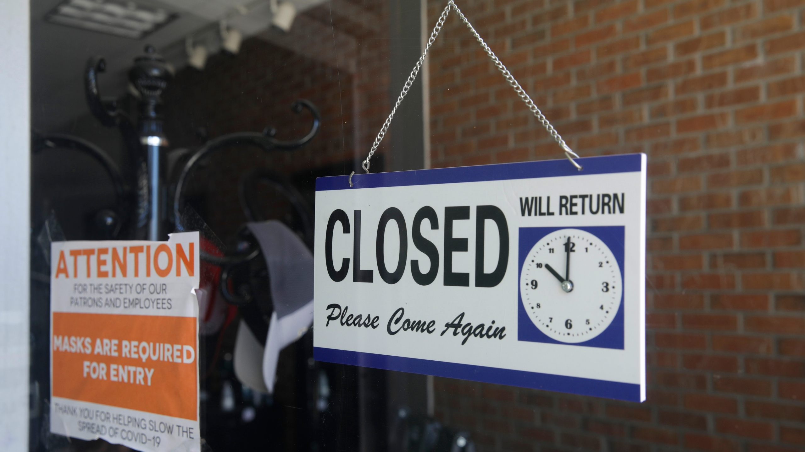 In this July 18, 2020, file photo a closed sign hangs in the window of a barber shop in Burbank, Calif. (AP Photo/Marcio Jose Sanchez)In this July 18, 2020, file photo a closed sign hangs in the window of a barber shop in Burbank, Calif. (AP Photo/Marcio Jose Sanchez)