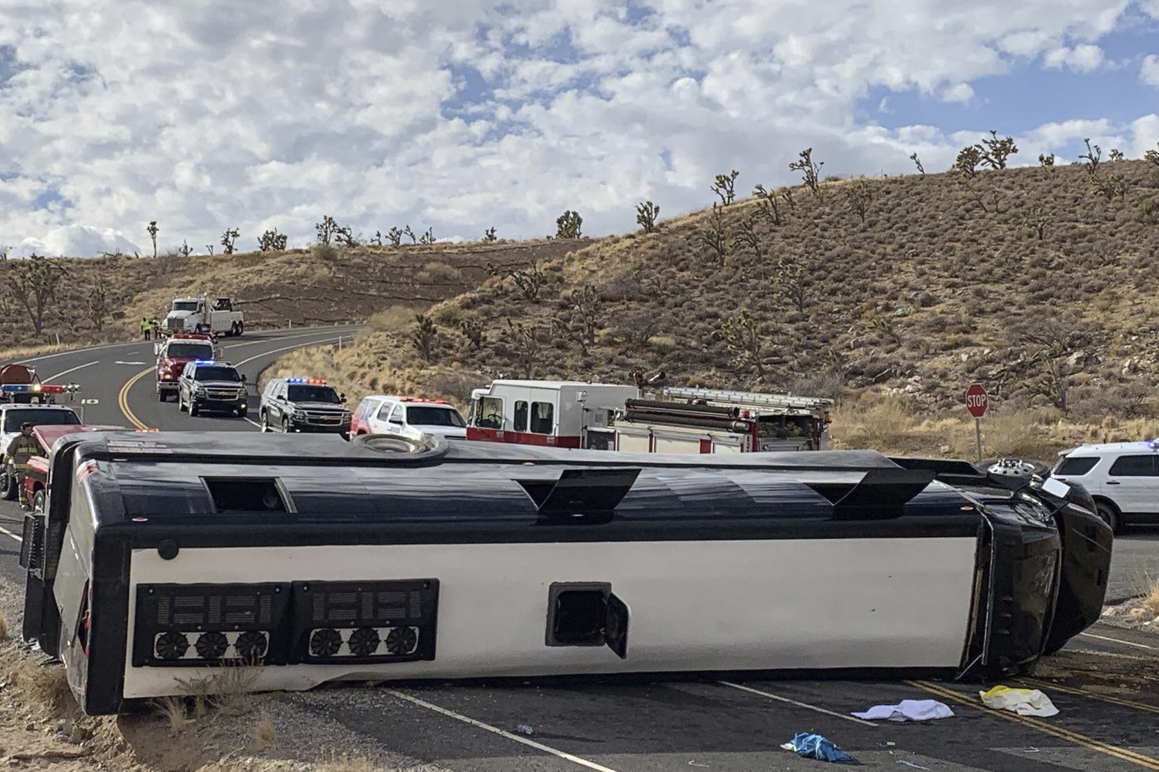 This photo provided by the Mohave County Sheriff's Office shows a Las Vegas-based tour that rolled over in northwestern Arizona on Friday, Jan. 22, 2021. (Mohave County Sheriff's Office via AP)