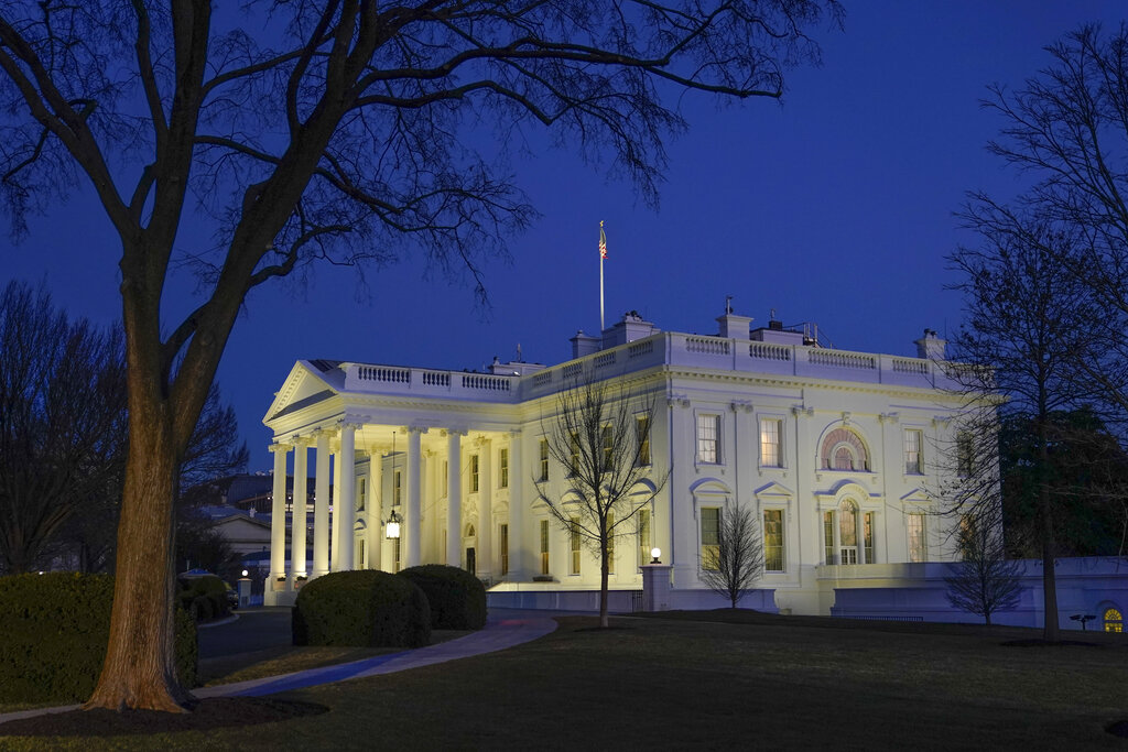 Dusk settles over the White House in Washington Jan. 23, 2021. (AP Photo/Patrick Semansky)