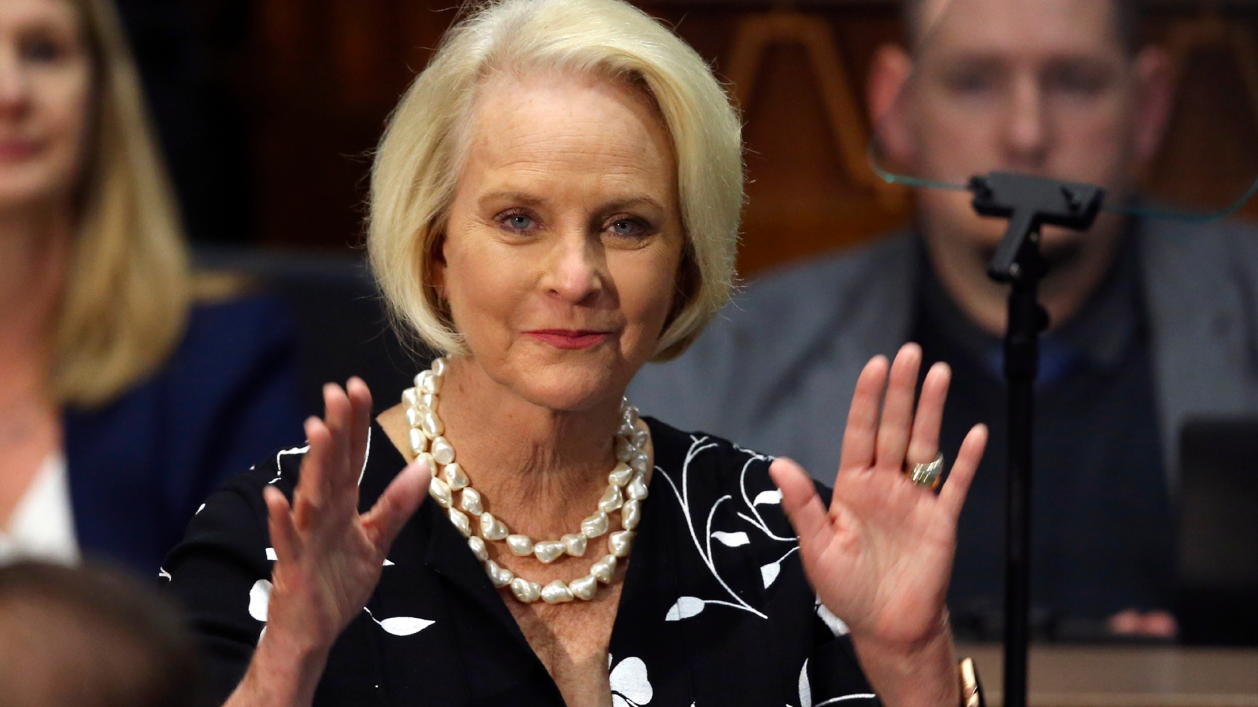 In this Jan. 13, 2020, file photo Cindy McCain, wife of former Arizona Sen. John McCain, waves to the crowd after being acknowledged by Arizona Republican Gov. Doug Ducey during his State of the State address on the opening day of the legislative session at the Capitol in Phoenix. (AP Photo/Ross D. Franklin)