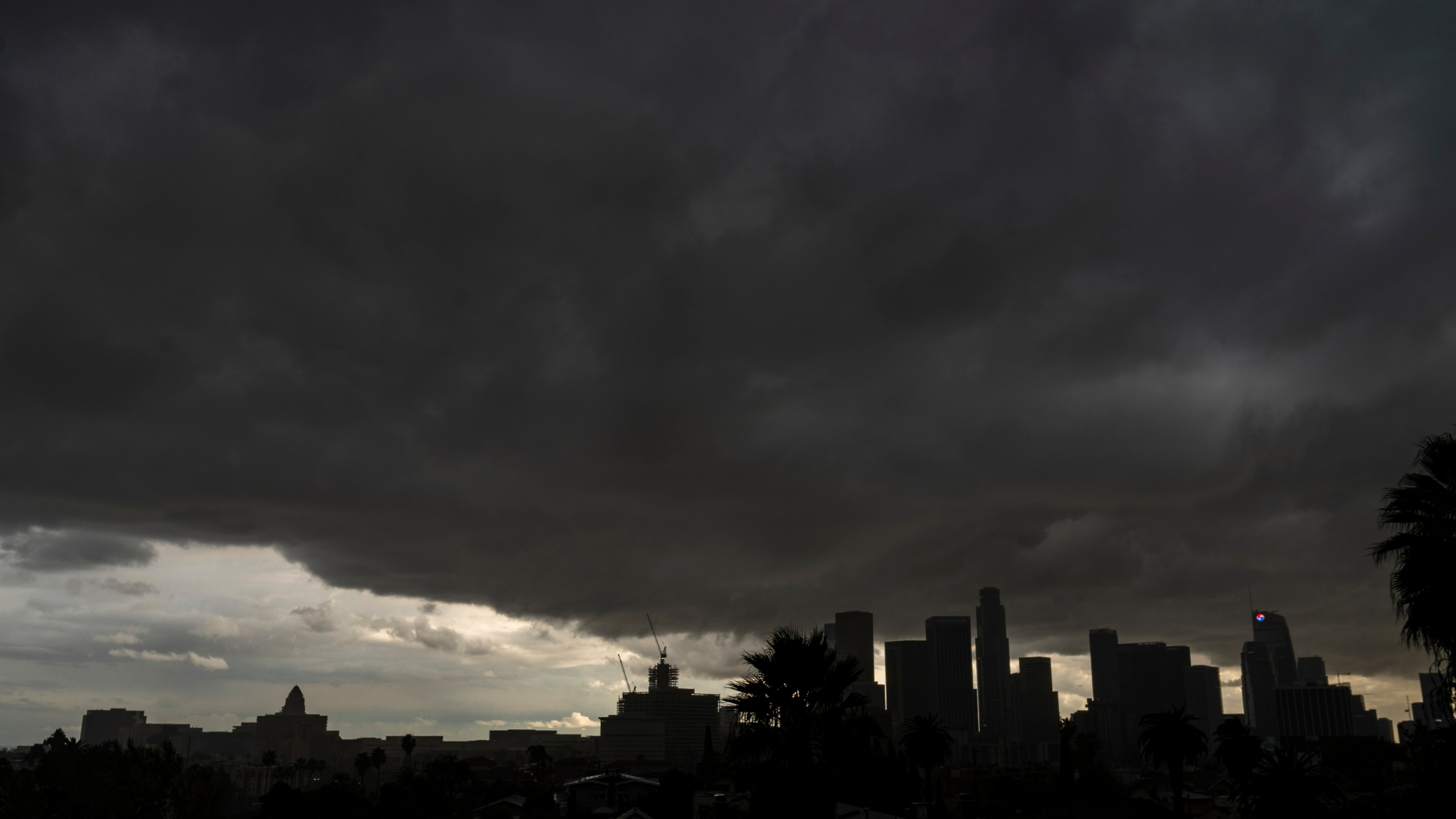 Heavy clouds move over the Los Angeles city skyline Saturday, Jan. 23, 2021. (AP Photo/Damian Dovarganes)