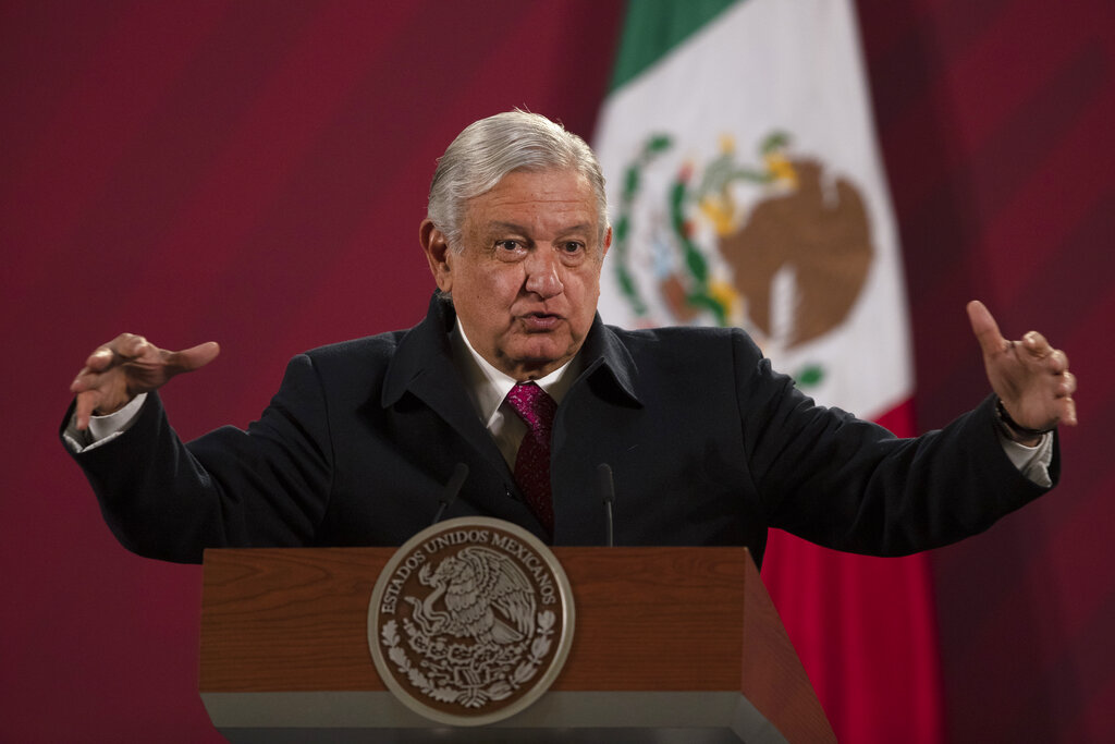 In this Dec. 18, 2020 file photo, Mexican President Andres Manuel Lopez Obrador gives his daily, morning news conference at the presidential palace, Palacio Nacional, in Mexico City. (AP Photo/Marco Ugarte, File)