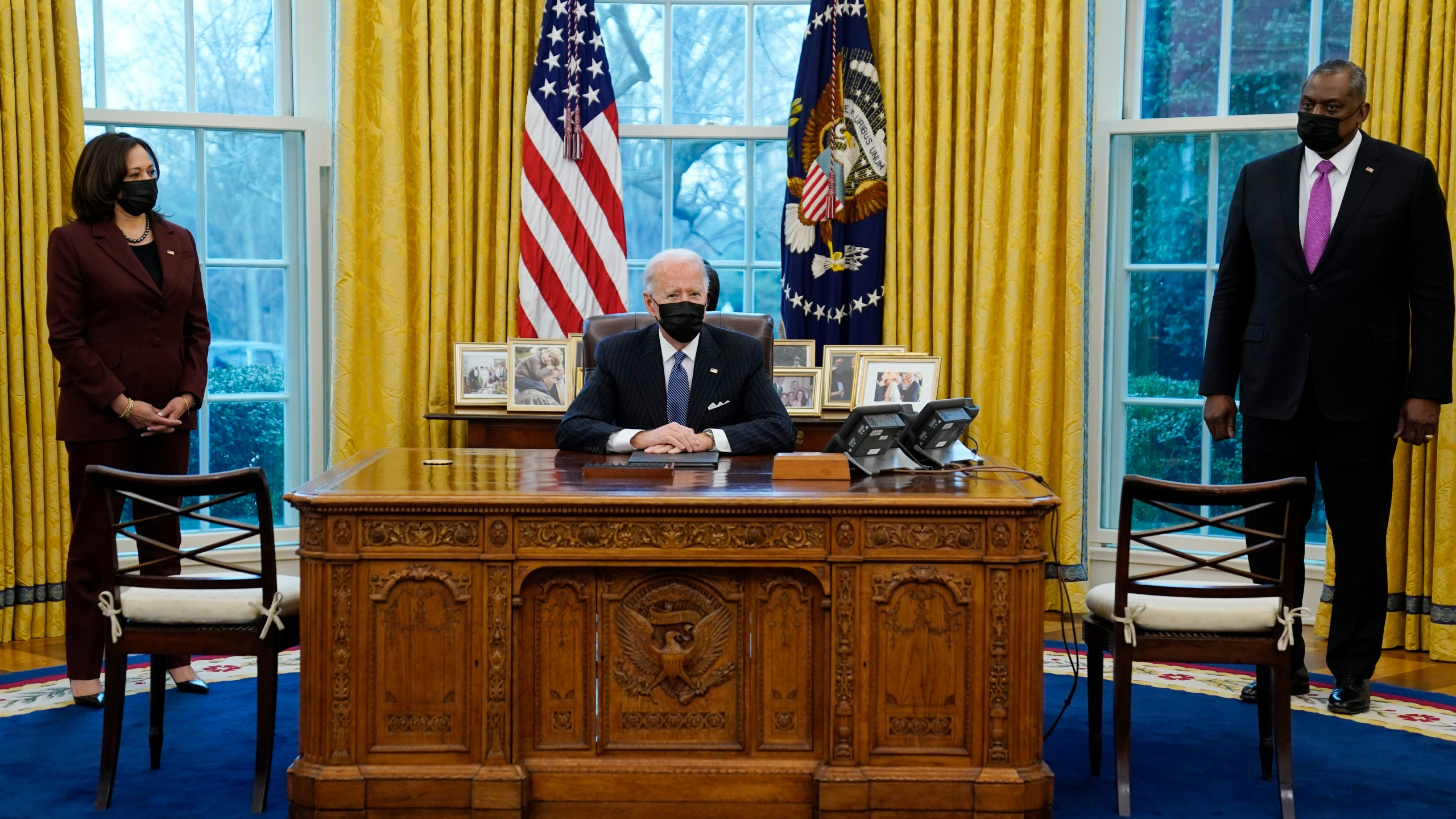 President Joe Biden meets with Secretary of Defense Lloyd Austin, Vice President Kamala Harris, in the Oval Office of the White House, Monday, Jan. 25, 2021, in Washington. (AP Photo/Evan Vucci)