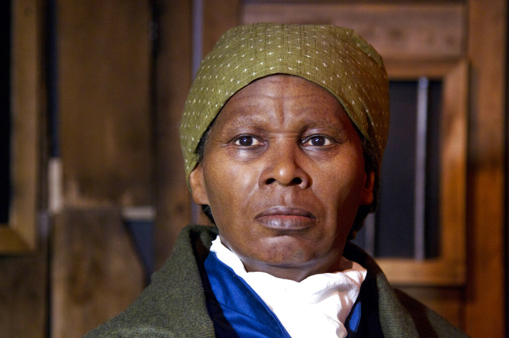 In this Feb. 7, 2012 file photo, a wax likeness of the renowned abolitionist and conductor of the Underground Railroad Harriet Ross Tubman is unveiled at the Presidents Gallery by Madame Tussauds in Washington. (AP Photo/Manuel Balce Ceneta)
