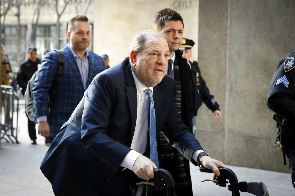 In this Feb. 24, 2020, file photo, Harvey Weinstein arrives at a Manhattan courthouse as jury deliberations continue in his rape trial in New York. (AP Photo/John Minchillo, File)