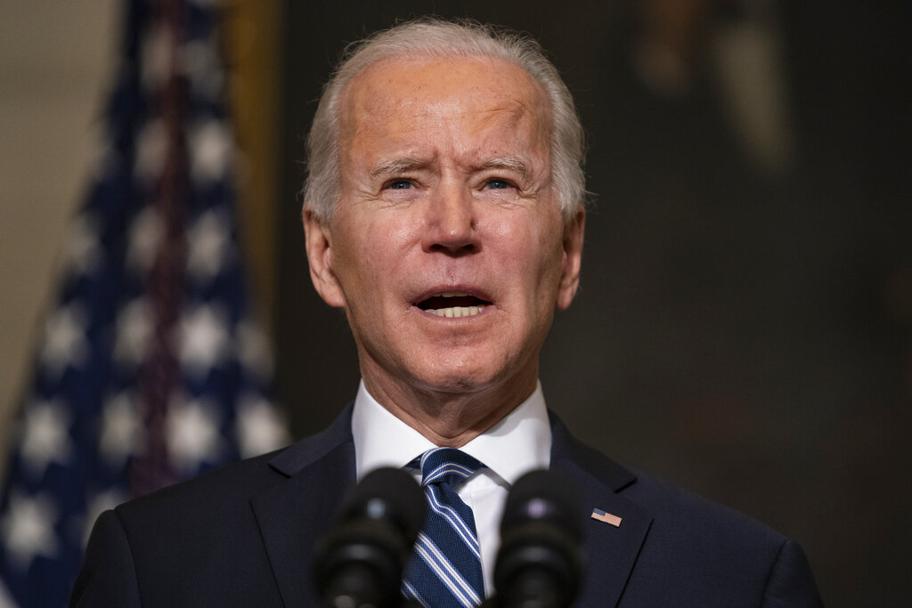 In this Jan. 27, 2021, photo, President Joe Biden speaks in the State Dining Room of the White House in Washington.