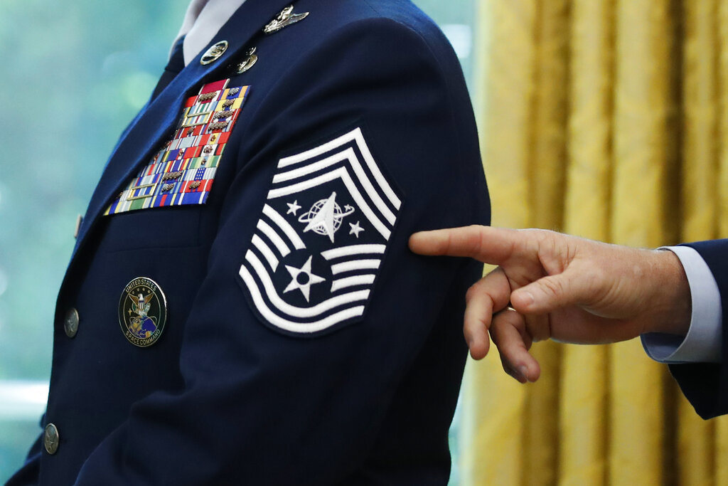 In this May 15, 2020, file photo, Chief Master Sgt. Roger Towberman displays his insignia during a presentation of the United States Space Force flag in the Oval Office of the White House in Washington. (AP Photo/Alex Brandon, File)