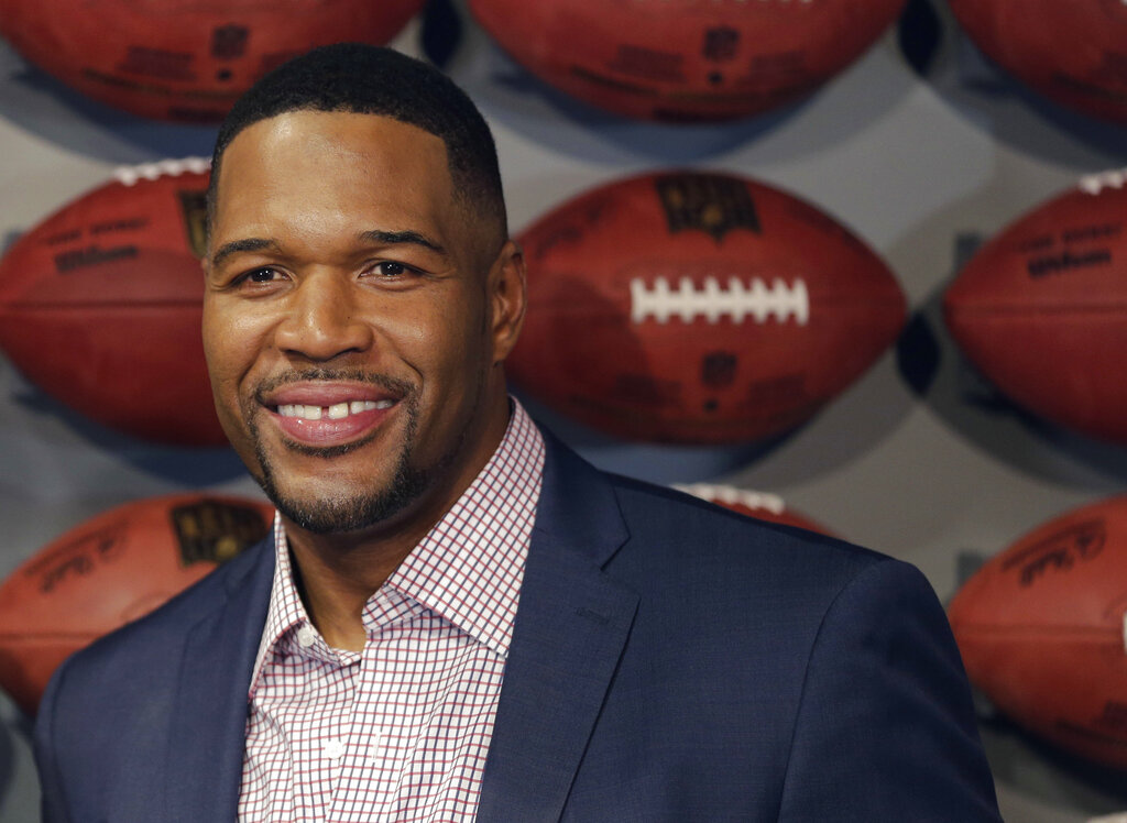 """In this Thursday, Nov. 30, 2017 file photo, Former New York Giant Michael Strahan poses for a picture at the opening of """"NFL Experience"""" in Times Square, New York. (AP Photo/Seth Wenig, File)"""