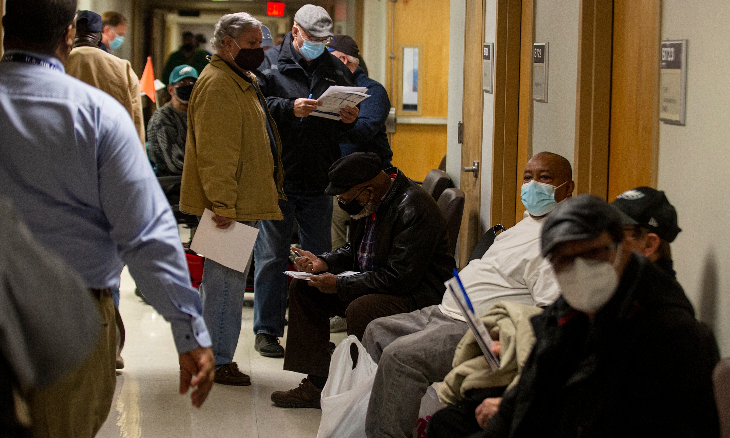 In this Jan. 23, 2021, file photo, veterans wait in line inside the VA Medical Center in Philadelphia to receive the COVID-19 vaccine during a walk-in clinic. (Tyger Williams/The Philadelphia Inquirer via AP)
