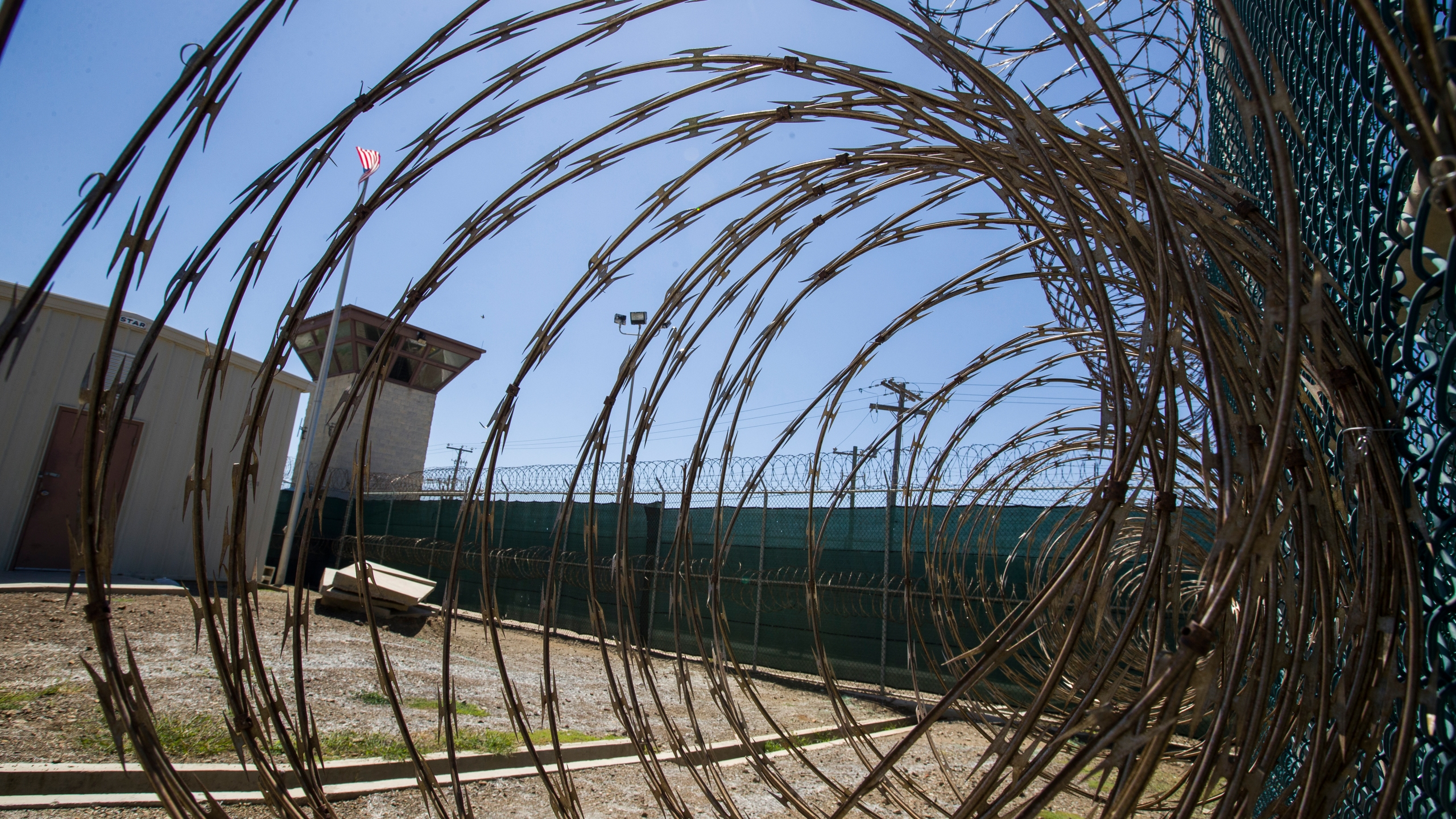 In this Wednesday, April 17, 2019 file photo reviewed by U.S. military officials, the control tower is seen through the razor wire inside the Camp VI detention facility in Guantanamo Bay Naval Base, Cuba. (AP Photo/Alex Brandon)