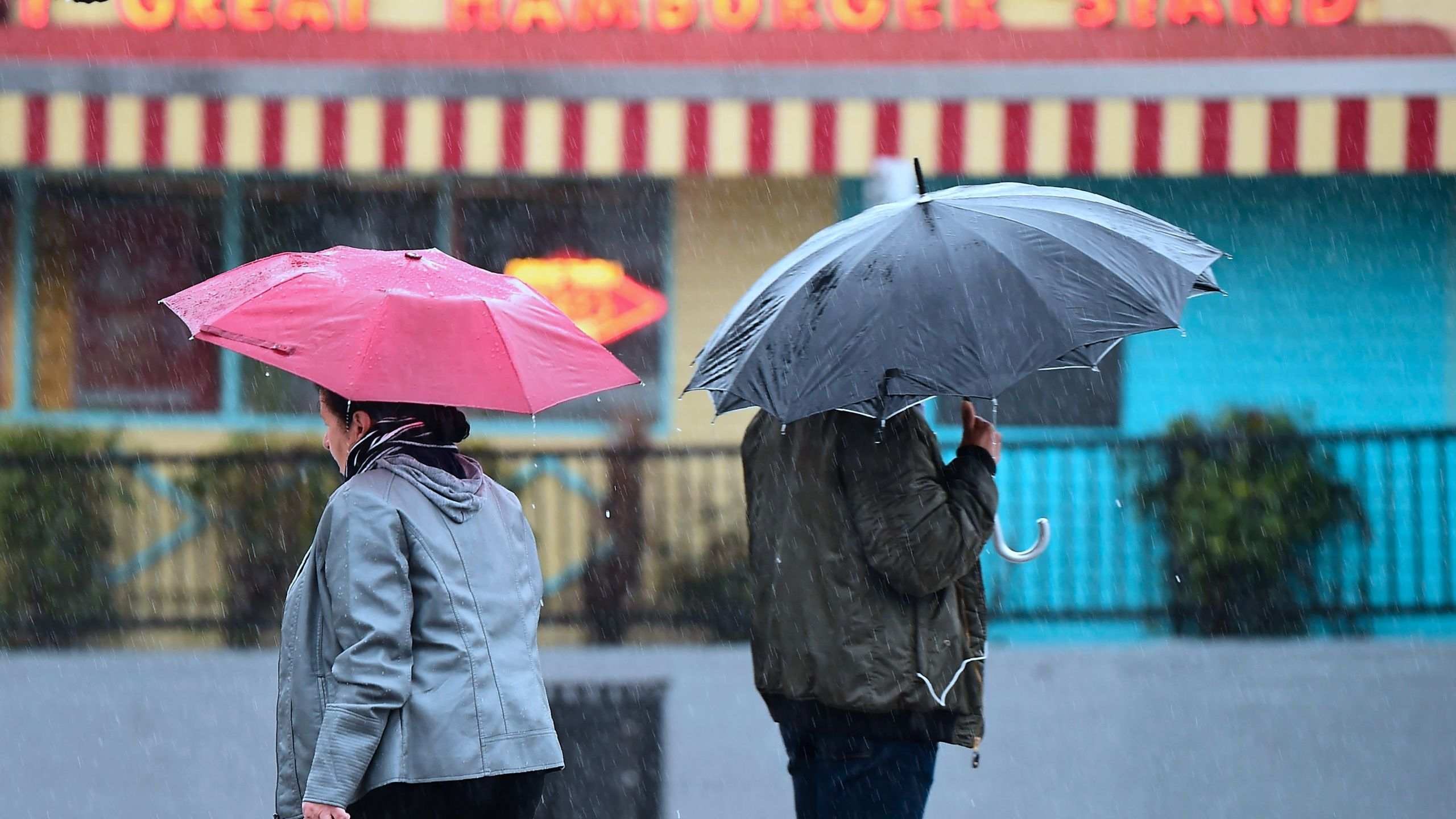 Pedestrians use umbrellas in the rain in Los Angeles, California on February 14, 2019, as southern California residents brace themselves for another heavy session of rainfall. (Frederic J. Brown/AFP via Getty Images)