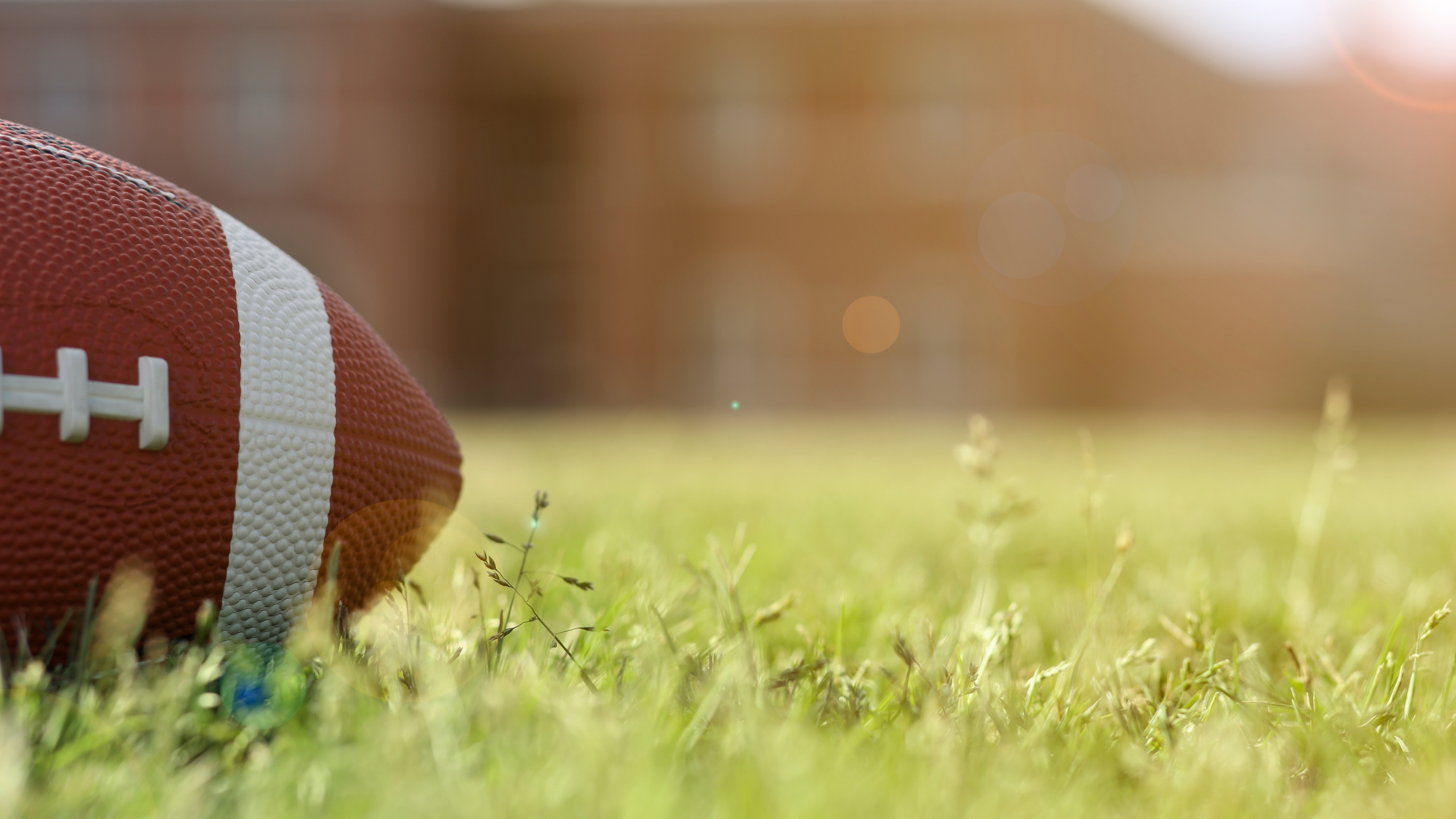 A file photo shows a football on grass. (Getty Images)