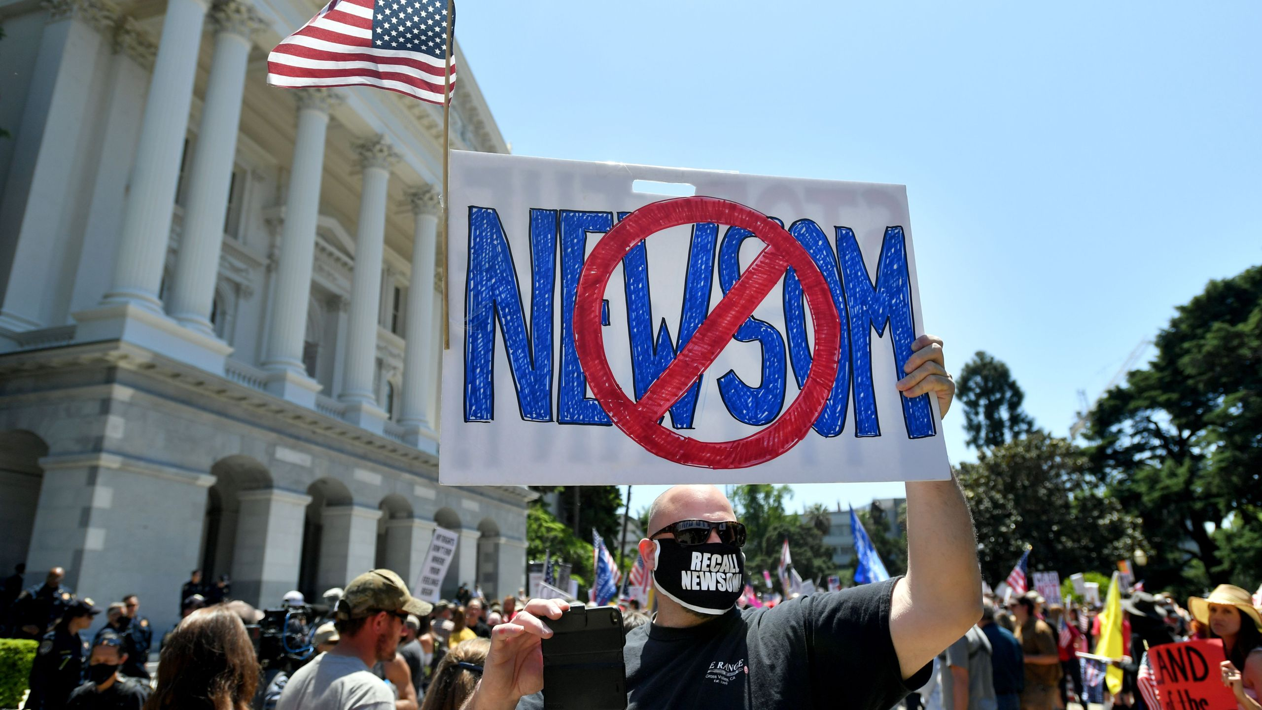 People gather to protest the stay-at-home orders outside the state capitol building in Sacramento, California on May 1, 2020. (JOSH EDELSON/AFP via Getty Images)