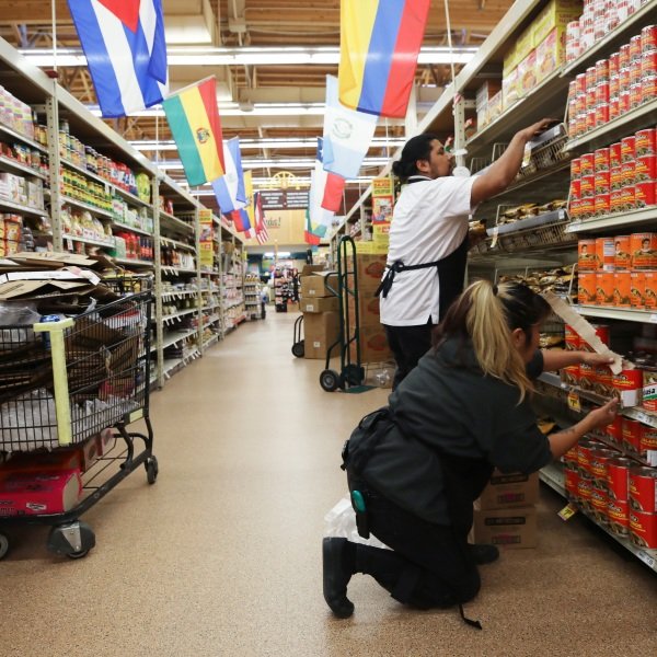 Workers re-stock items during special hours open only to seniors and the disabled at Northgate Gonzalez Market, a Hispanic specialty supermarket, on March 19, 2020 in Los Angeles, California. (Mario Tama/Getty Images)