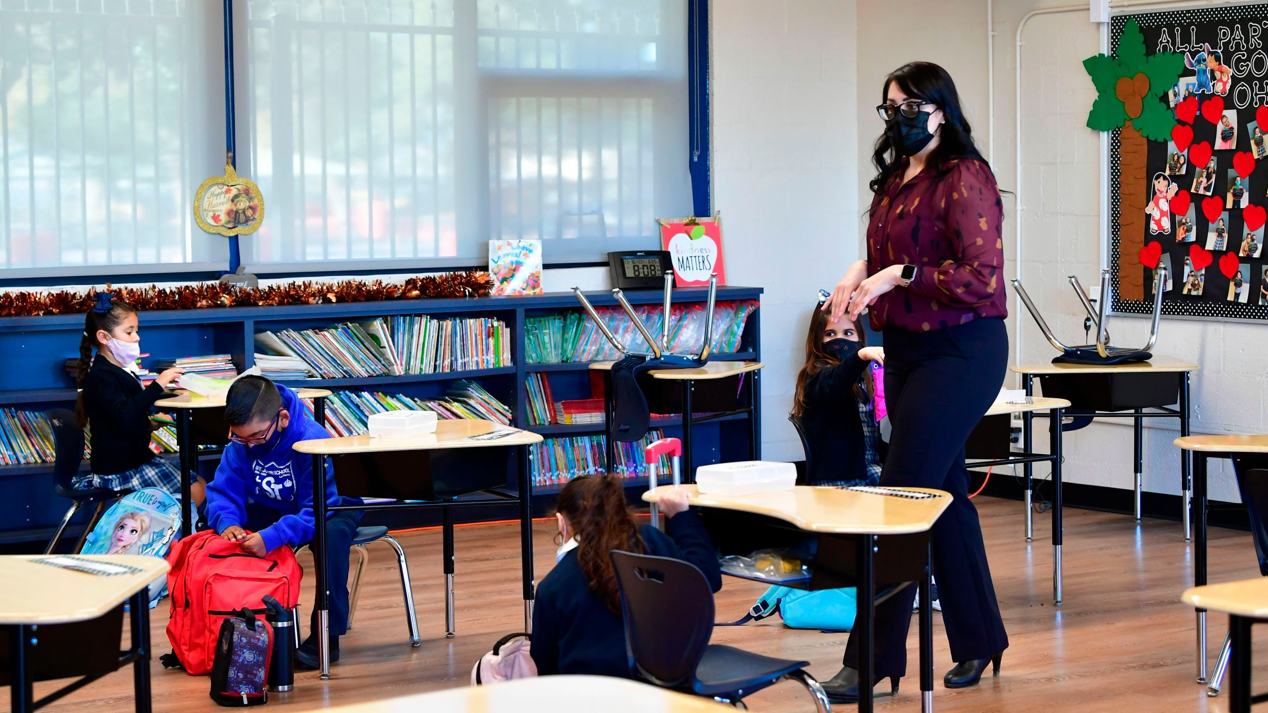 First grade instructor Laura Sanchez speaks to her returning students at St. Joseph Catholic School in La Puente, California on November 16, 2020, where pre-kindergarten to Second Grade students in need of special services returned to the classroom today for in-person instruction. (Frederic J. Brown/AFP via Getty Images)