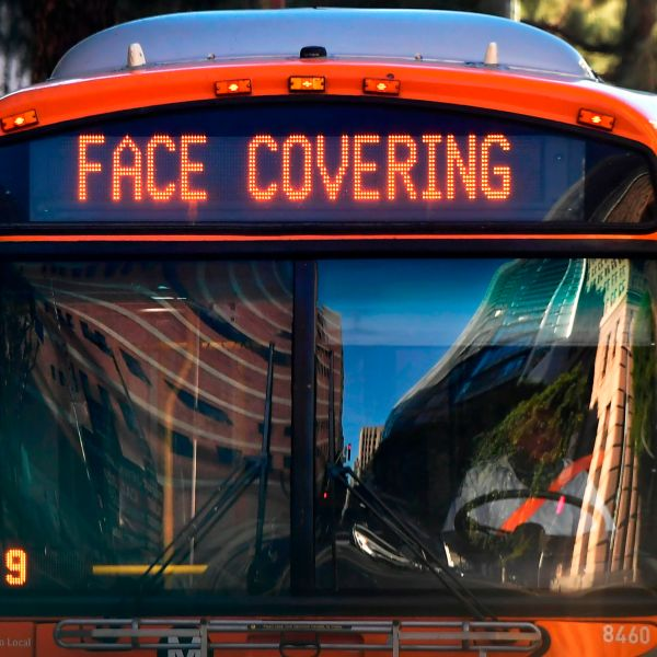 A reminder to wear face coverings is displayed on a bus in Los Angeles on Nov. 30, 2020. (FREDERIC J. BROWN/AFP via Getty Images)