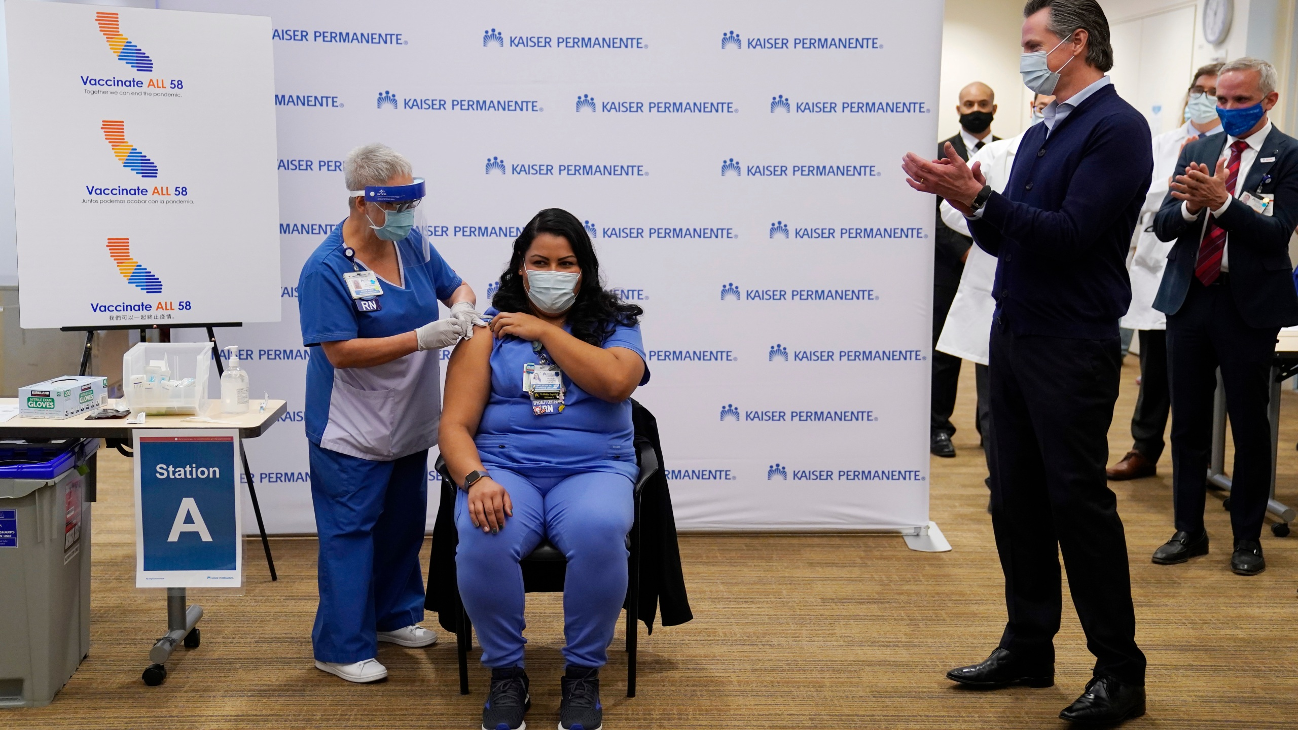 Gov. Gavin Newsom watches as ICU nurse Helen Cordova receives the Pfizer-BioNTech COVID-19 vaccine at Kaiser Permanente Los Angeles Medical Center on Dec. 14, 2020. (Jae C. Hong-Pool/Getty Images)