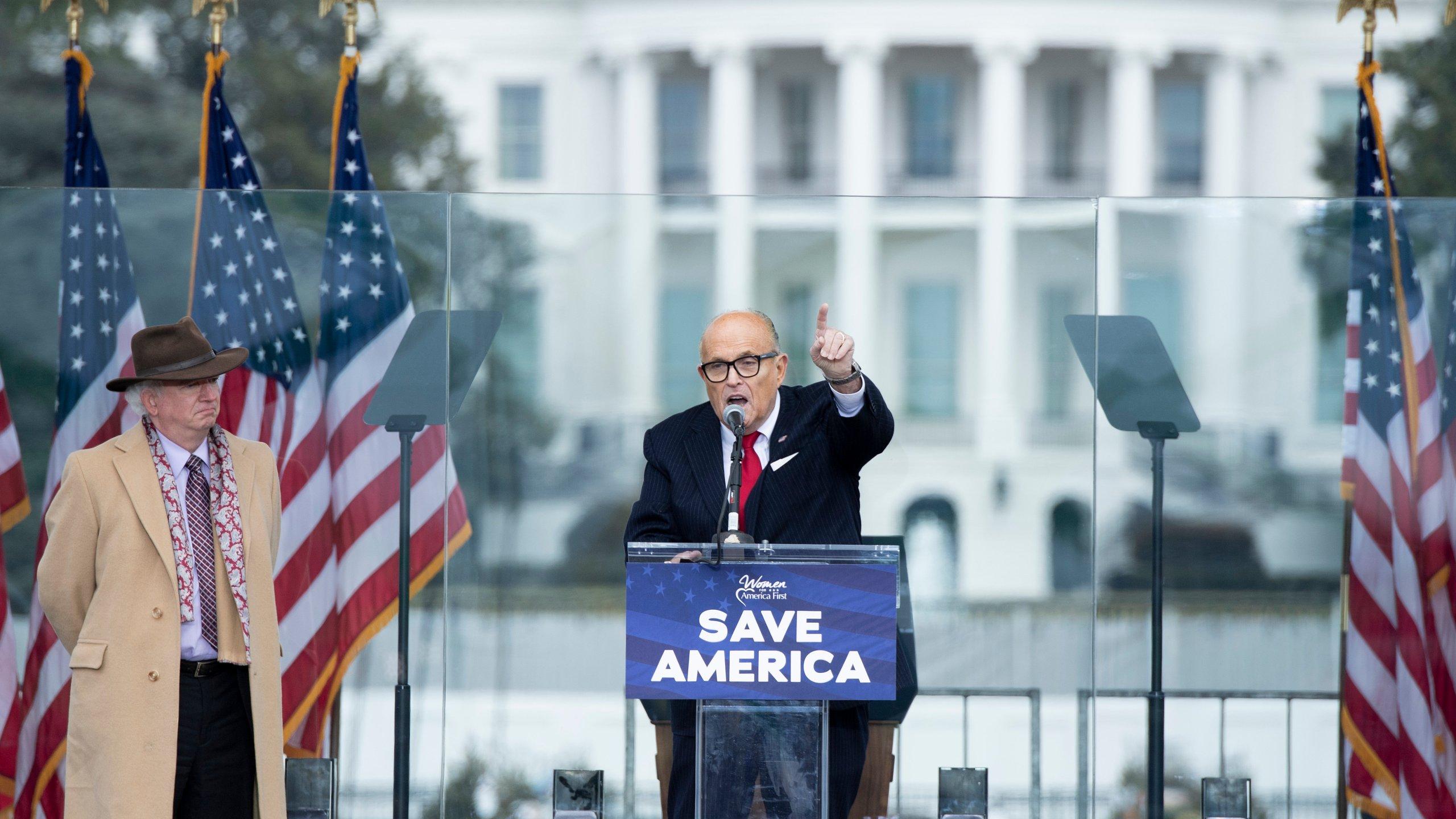 Chapman University professor John Eastman stands next to Rudy Giuliani during a rally near the White House in Washington, D.C., on Wednesday, Jan. 6, 2021. (BRENDAN SMIALOWSKI/AFP via Getty Images)