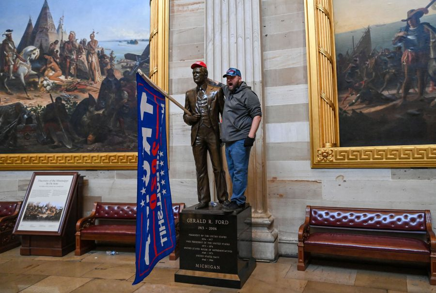 Supporters of President Donald Trump enter the US Capitol's Rotunda on January 6, 2021, in Washington, DC. (SAUL LOEB/AFP via Getty Images)