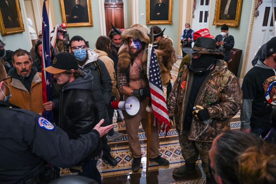 U.S. Capitol police officers try to stop supporters of President Donald Trump to enter the Capitol on January 6, 2021, in Washington, DC. (SAUL LOEB/AFP via Getty Images)