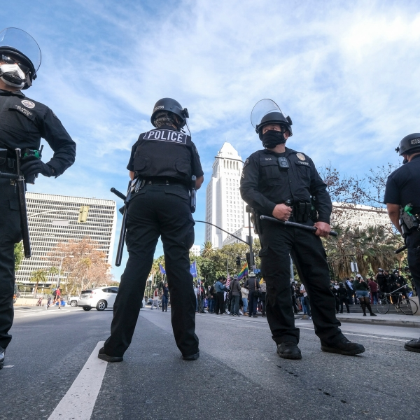 Police officers stand guard during a protest in support of President Donald Trump in Los Angeles on Jan. 6, 2021, the same day the U.S. Capitol was stormed. (Ringo Chiu / AFP / Getty Images)
