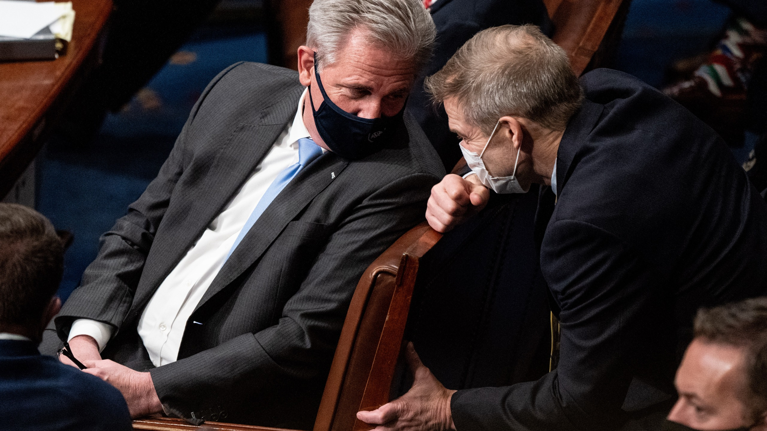 House Minority Leader Kevin McCarthy (R-CA) and Rep. Jim Jordan (R-OH) talk during a joint session of Congress on Jan. 6, 2021 in Washington, DC. Congress has reconvened to ratify President-elect Joe Biden's 306-232 Electoral College win over President Donald Trump, hours after a pro-Trump mob broke into the U.S. Capitol and disrupted proceedings. (Erin Schaff - Pool/Getty Images)