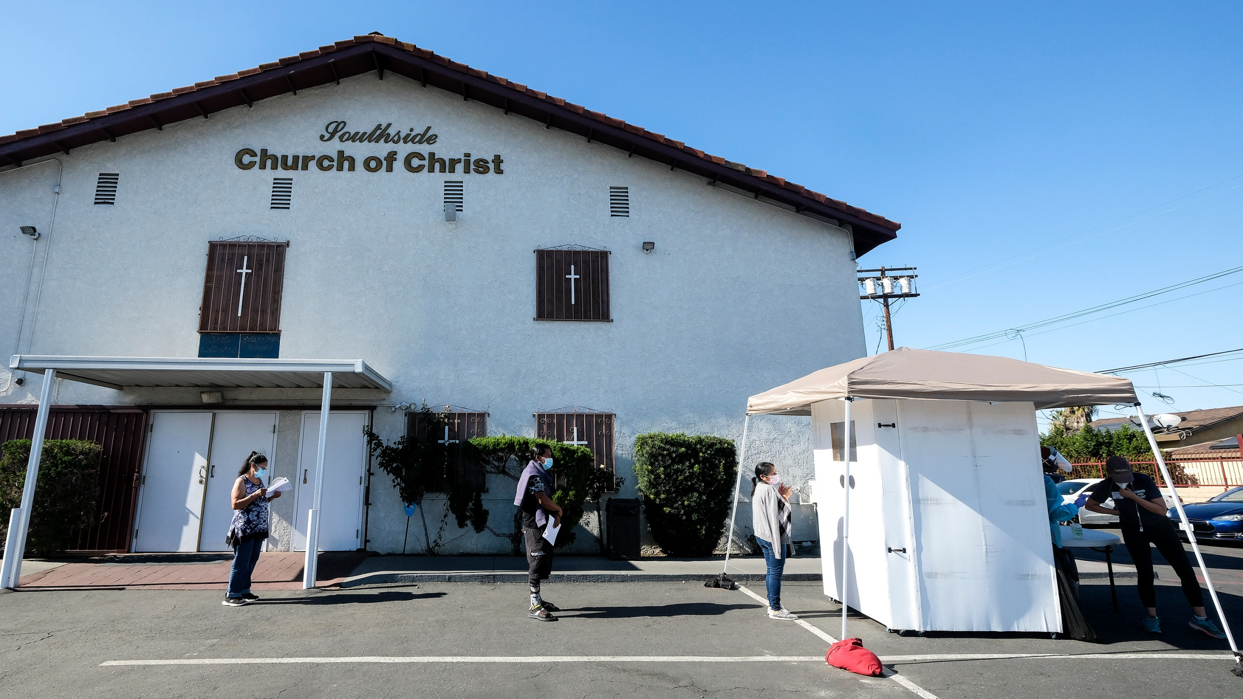 People wait in line at the Southside Church of Christ in Los Angeles, California, on January 18, 2021 as free rapid Covid-19 antibody and PCR tests are administered to local residents in honor of Martin Luther King Jr. Day. (Ringo Chiu/AFP via Getty Images)