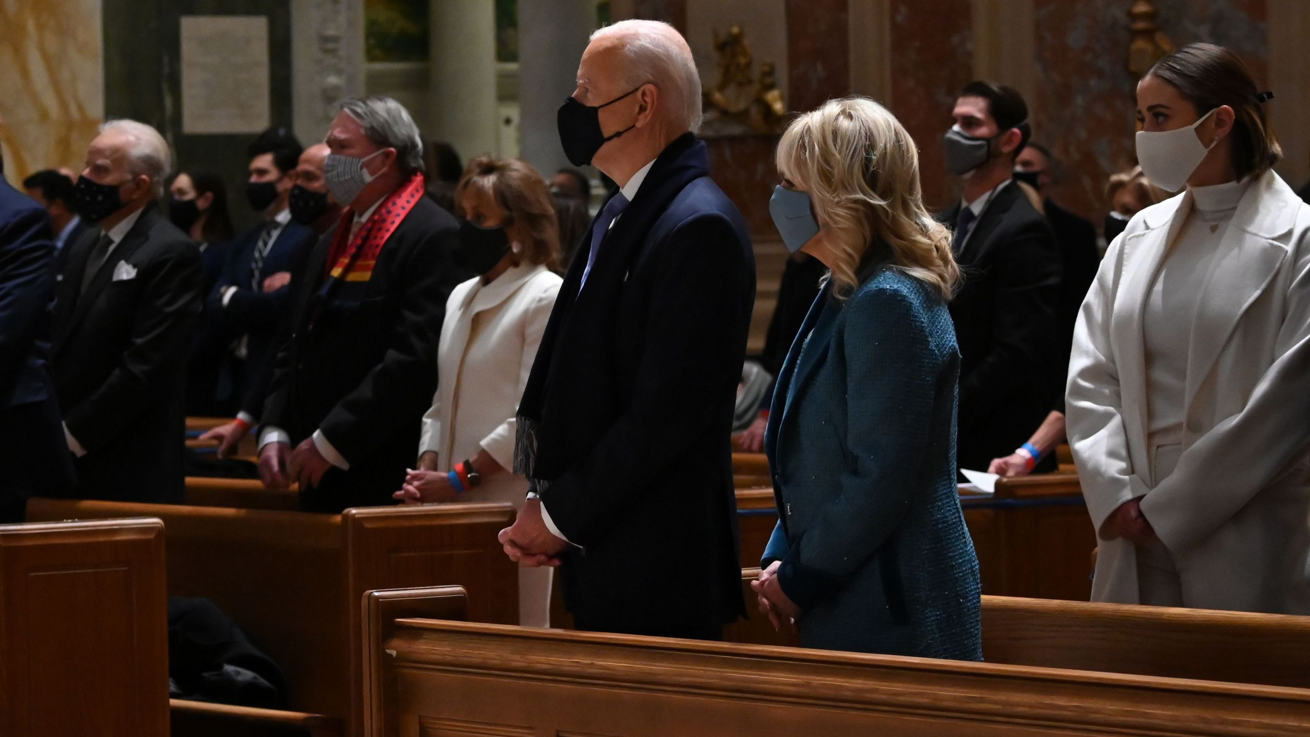 US President-elect Joe Biden (CL) and incoming First Lady Jill Biden attend Mass at the Cathedral of St. Matthew the Apostle in Washington, DC, on January 20, 2021. (JIM WATSON/AFP via Getty Images)