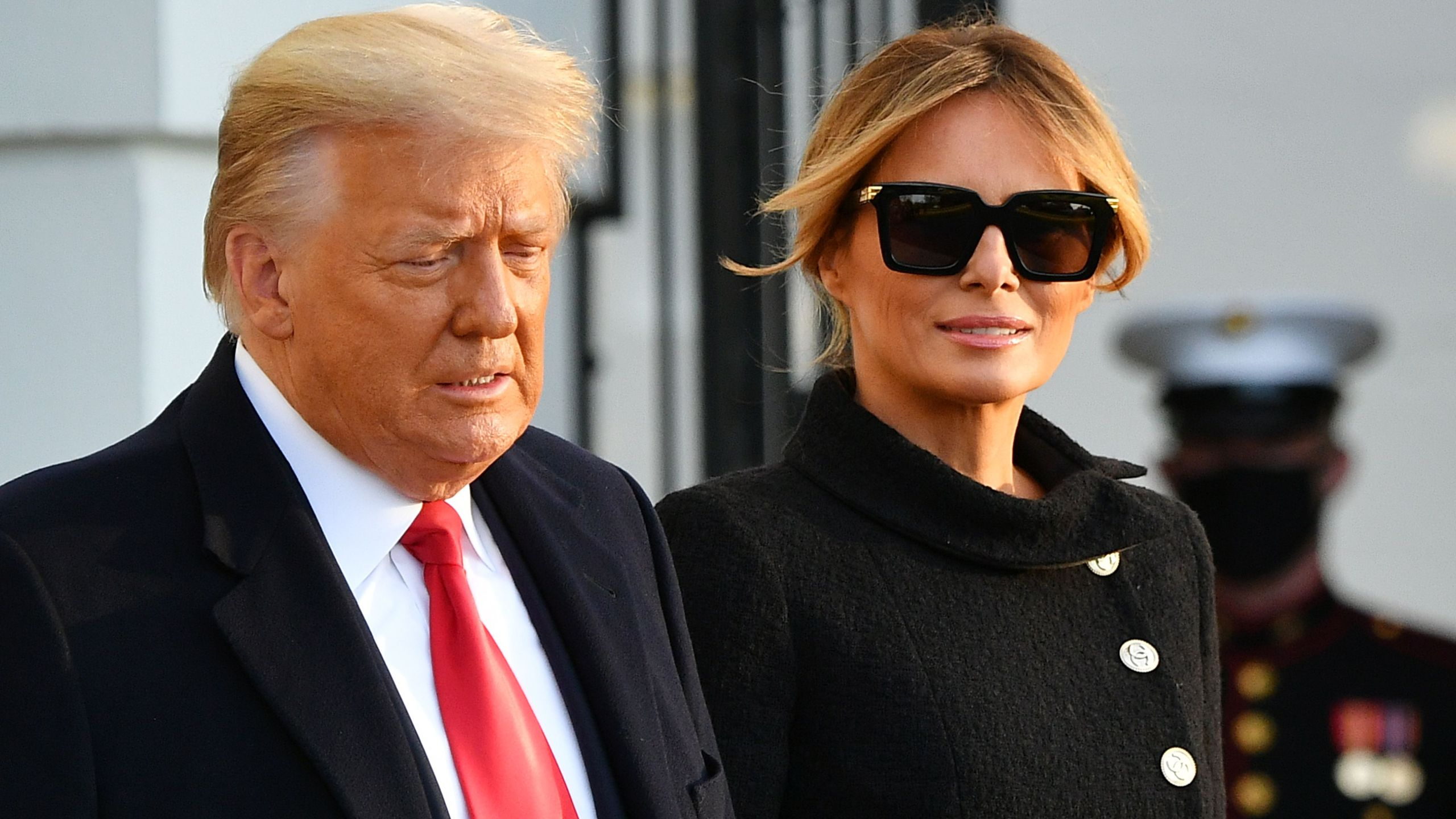 US President Donald Trump and First Lady Melania Trump make their way to board Marine One as they depart the White House in Washington, DC, on January 20, 2021. (MANDEL NGAN/AFP via Getty Images)
