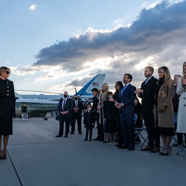 President Donald Trump and first lady Melania Trump meet Ivanka Trump (second from right), husband Jared Kushner (right), their children, Eric and Donald Jr. (both center-right) and Trump family members stand on the tarmac at Joint Base Andrews in Maryland as the outgoing president departs on Jan. 20, 2021. (Alex Edelman / AFP / Getty Images)